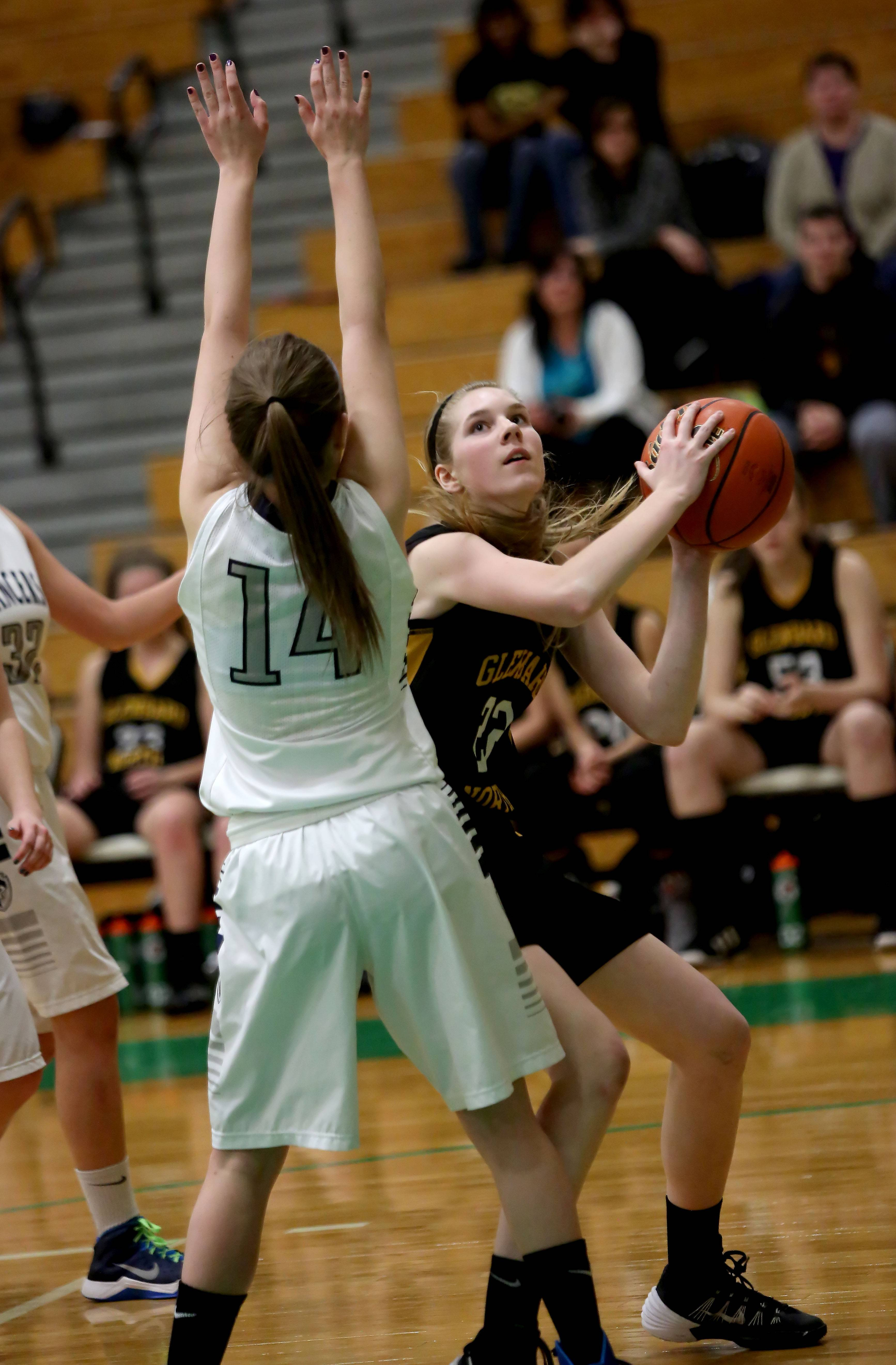 Jennifer Deegan of Glenbard North, right, looks to shoot against Lake Park in Class 4A regional quarterfinal girls basketball at York High School on Tuesday.