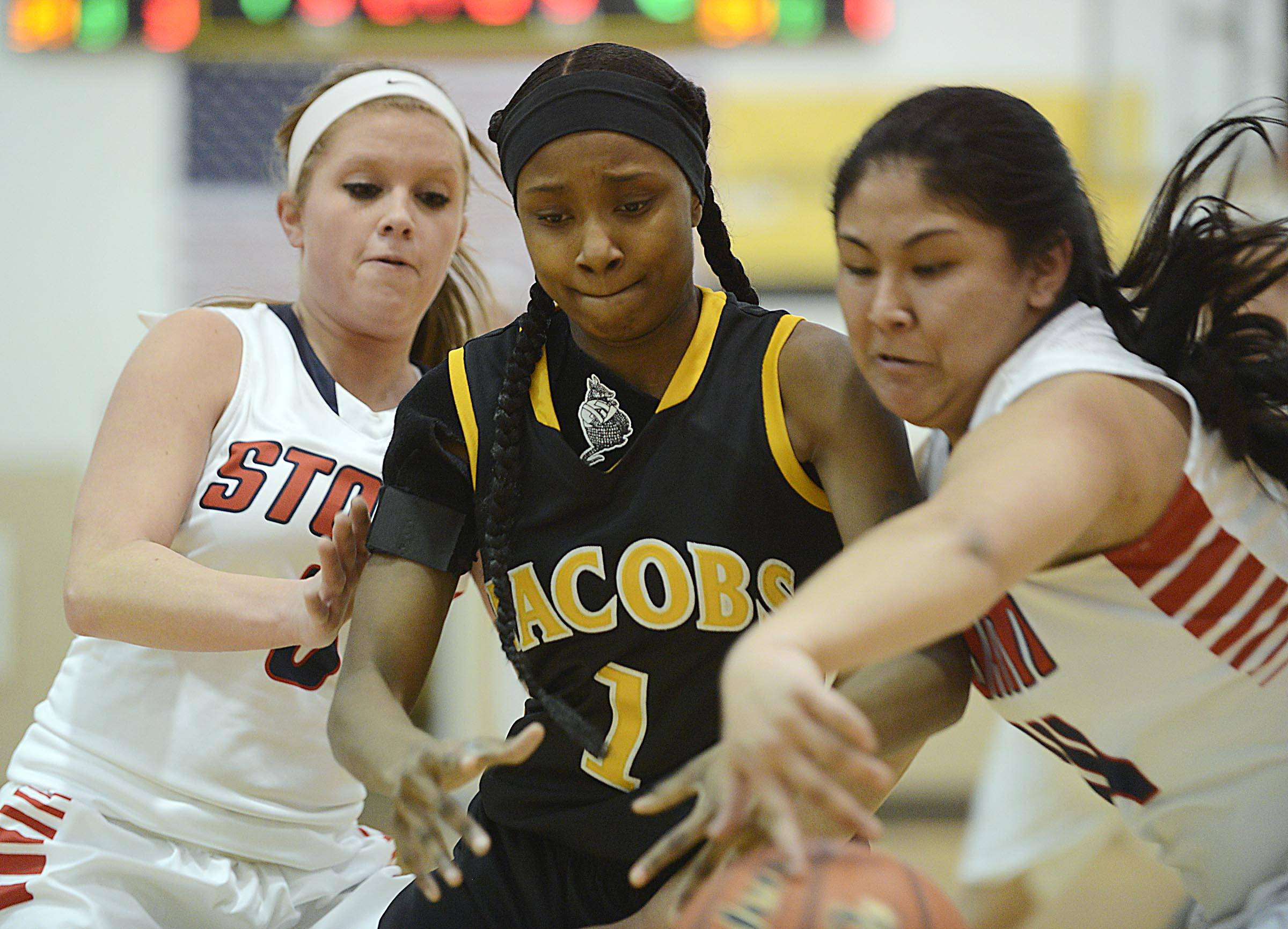 South Elgin's Nadia Yang steals a pass for Jacobs' Glenita Williams. At left is South Elgin's Mackie Kelleher.
