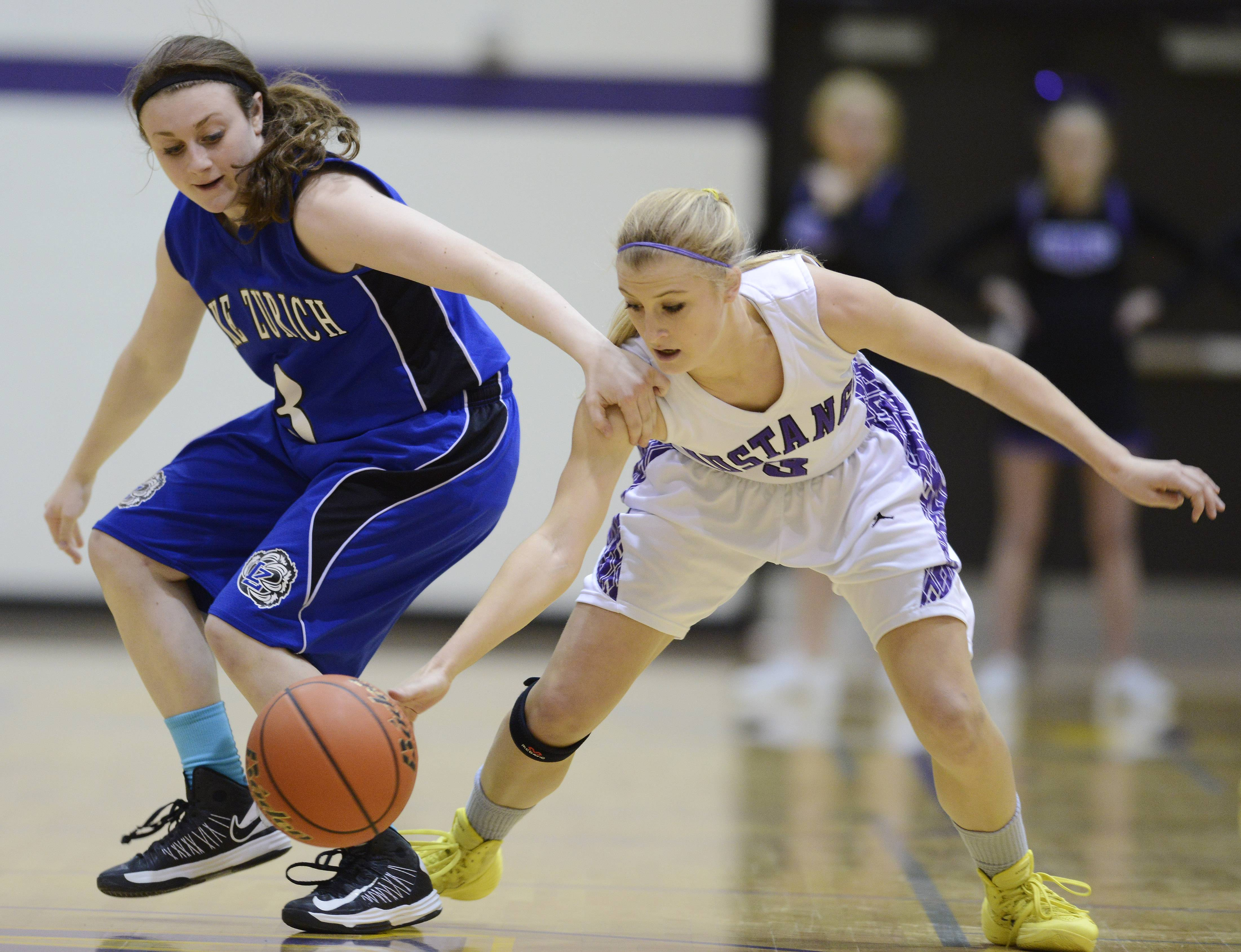 Rolling Meadows' Jackie Kemph, right, steals the ball from Lake Zurich's Frankie Nasco.