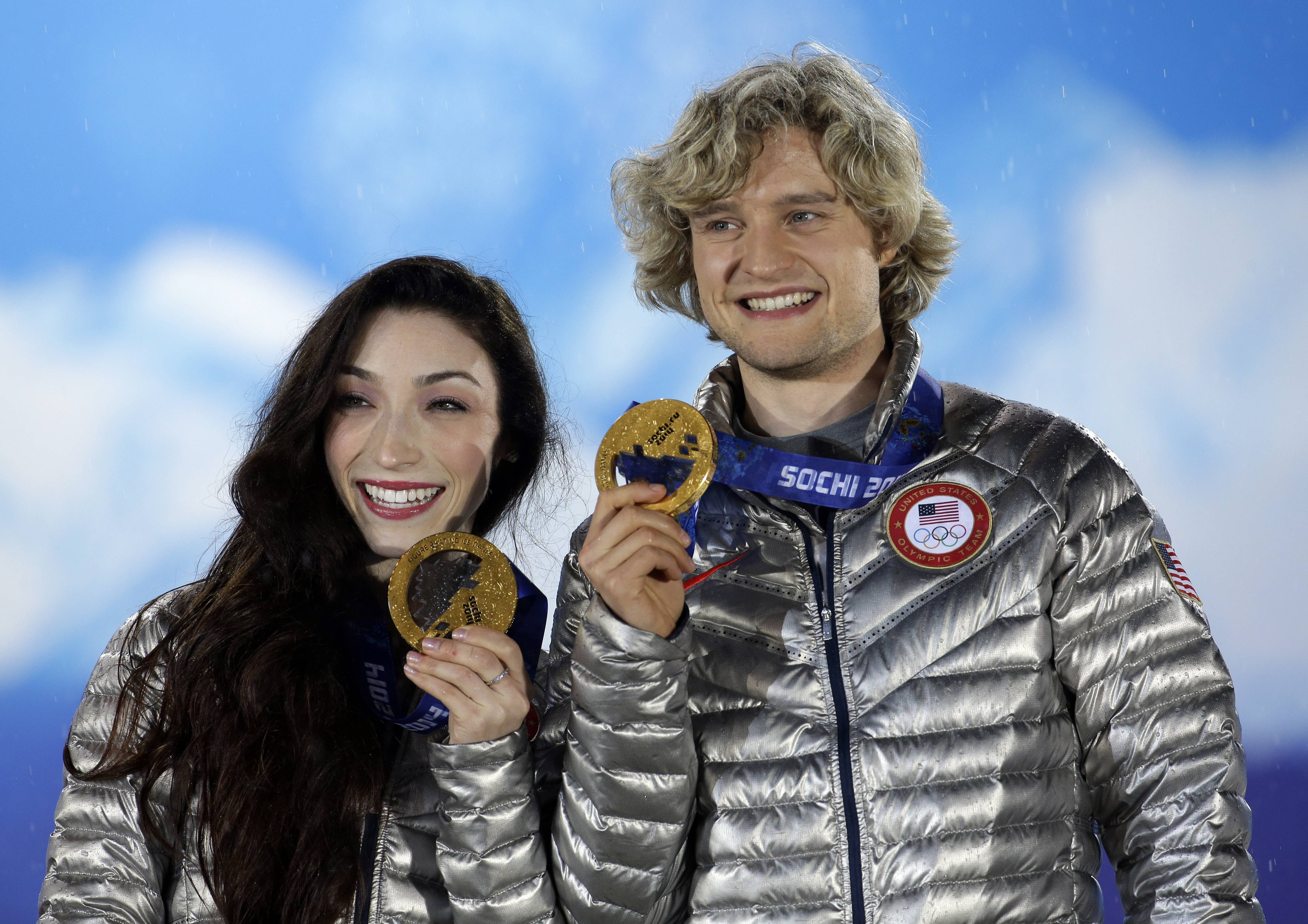 Ice dance figure skating gold medalists Meryl Davis and Charlie White of the United States pose with their medals.