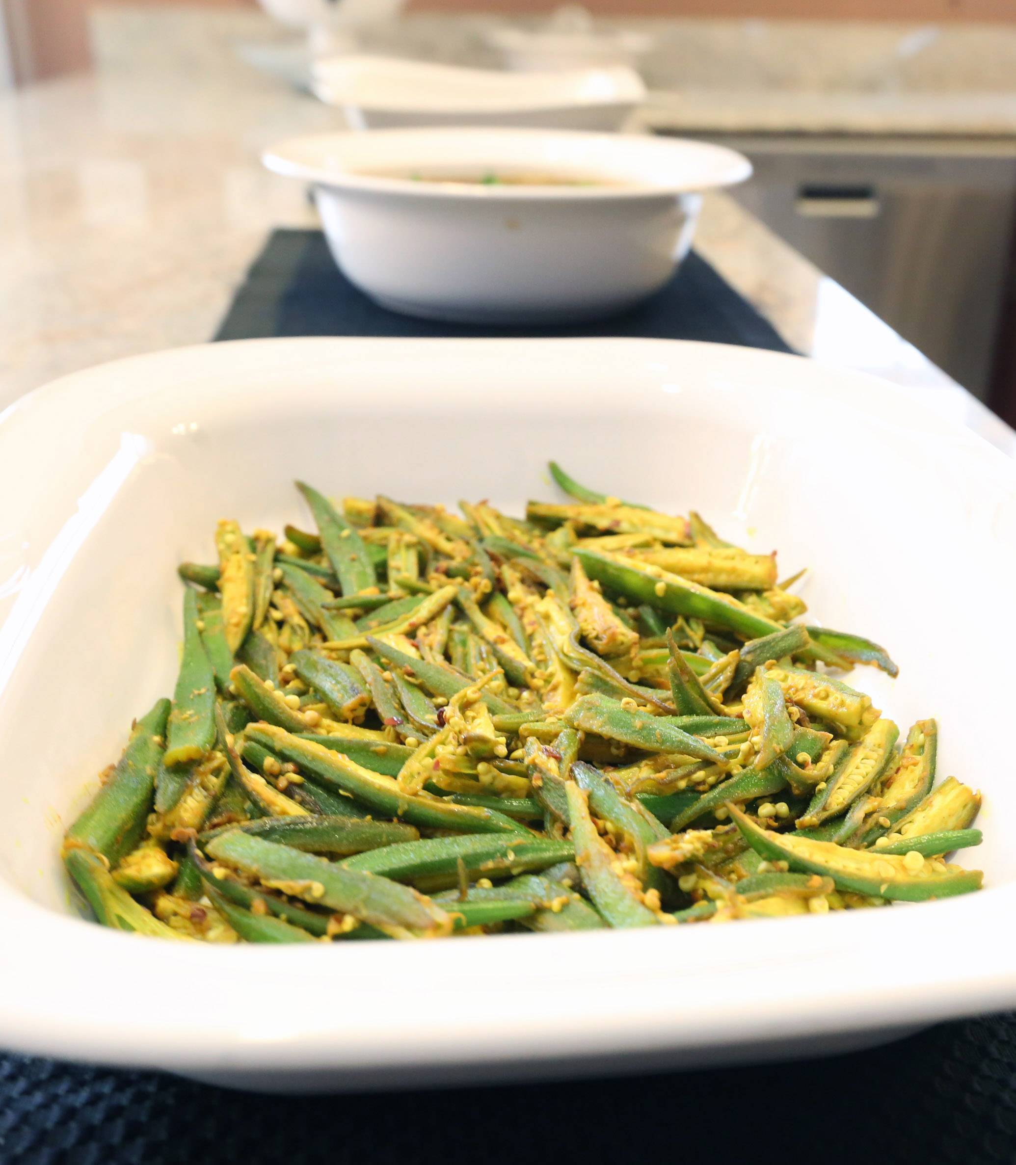 Cook of the Week Sushma Bhanot adds lemon juice to cooked okra to keep the vegetable's signature sliminess in check.