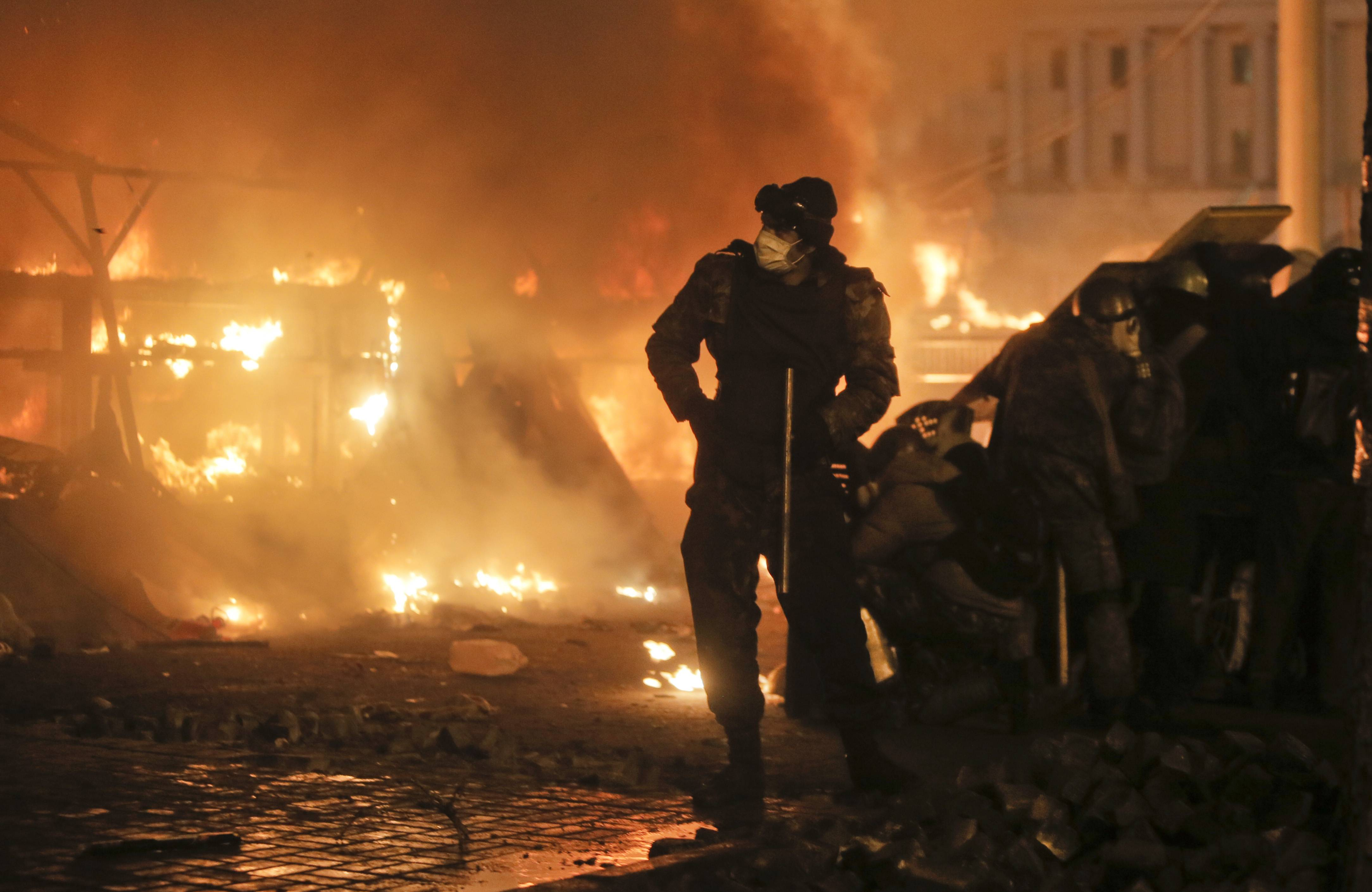 Anti-government protesters clash with riot police in Kiev's Independence Square, the epicenter of the country's unrest. Thousands of police armed with stun grenades and water cannons attacked the large opposition camp in Ukraine's capital on Tuesday.