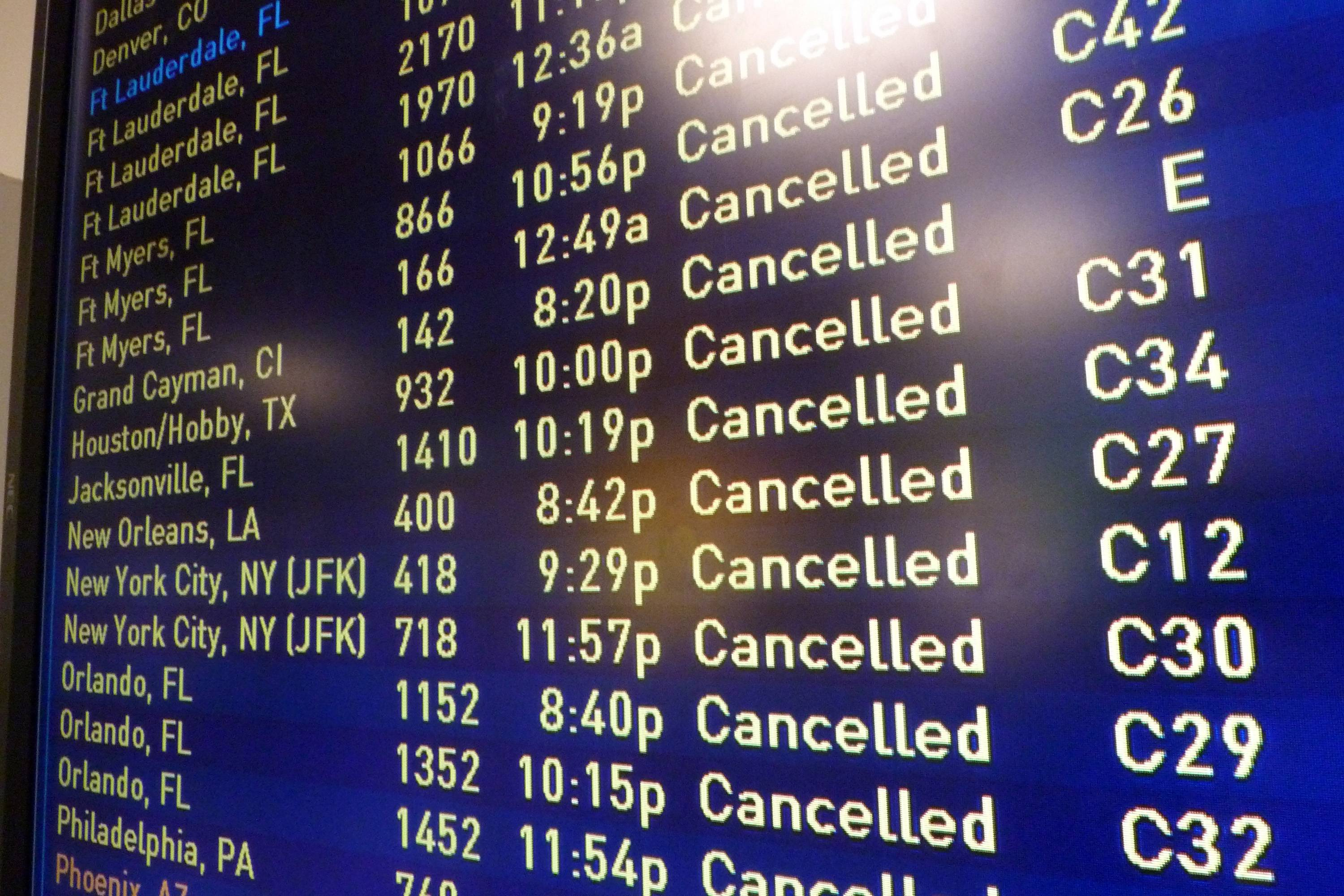 A board displays canceled flights at Logan International Airport in Boston on Saturday evening, Feb. 15, 2014. Another round of snow made its way into the Northeast on the heels of a storm that brought snow and ice to the East Coast, caused at least 25 deaths and left hundreds of thousands without power.