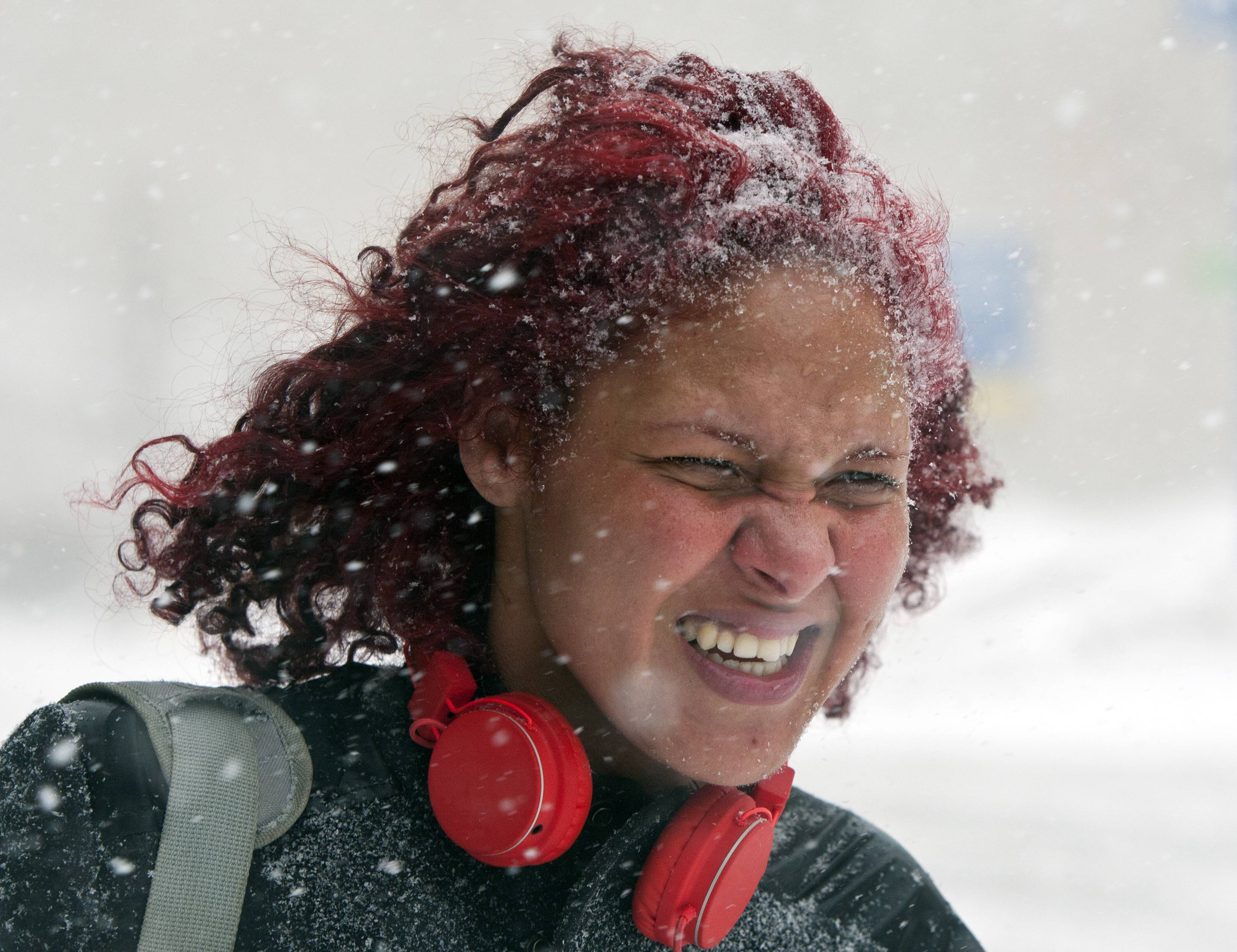 Grand Rapids Community College student Christina Lewis walks during a winter snowstorm, Monday, Feb. 17, 2014, in downtown Grand Rapids, Mich.