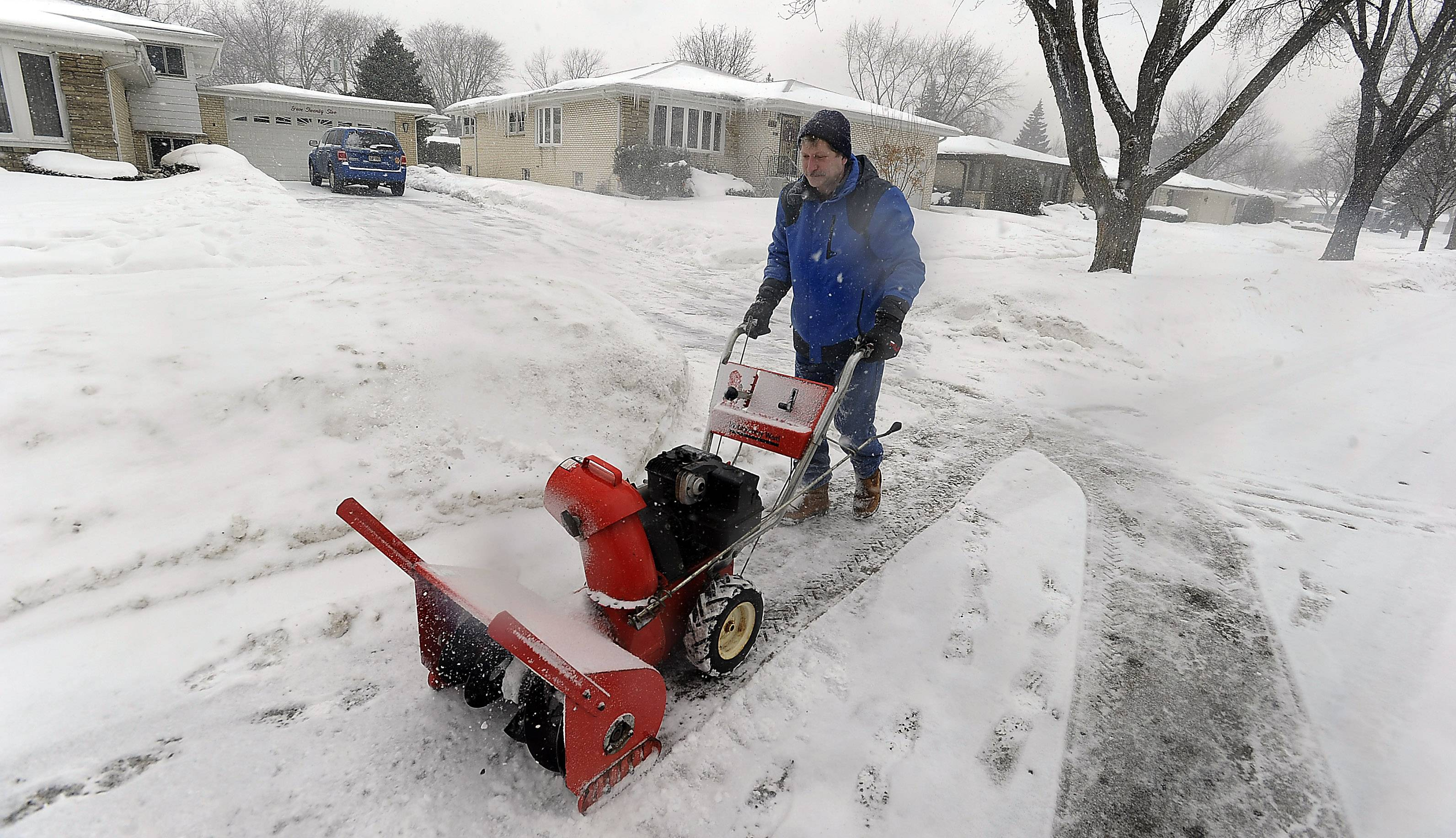 Armed with the used Montgomery Ward snowblower his wife found at a garage sale in 1985, Jim Sieburg plows a path for an elderly widow in his Des Plaines neighborhood. Sieburg, who celebrates his 57th birthday today, has been lending a hand to neighbors for decades.