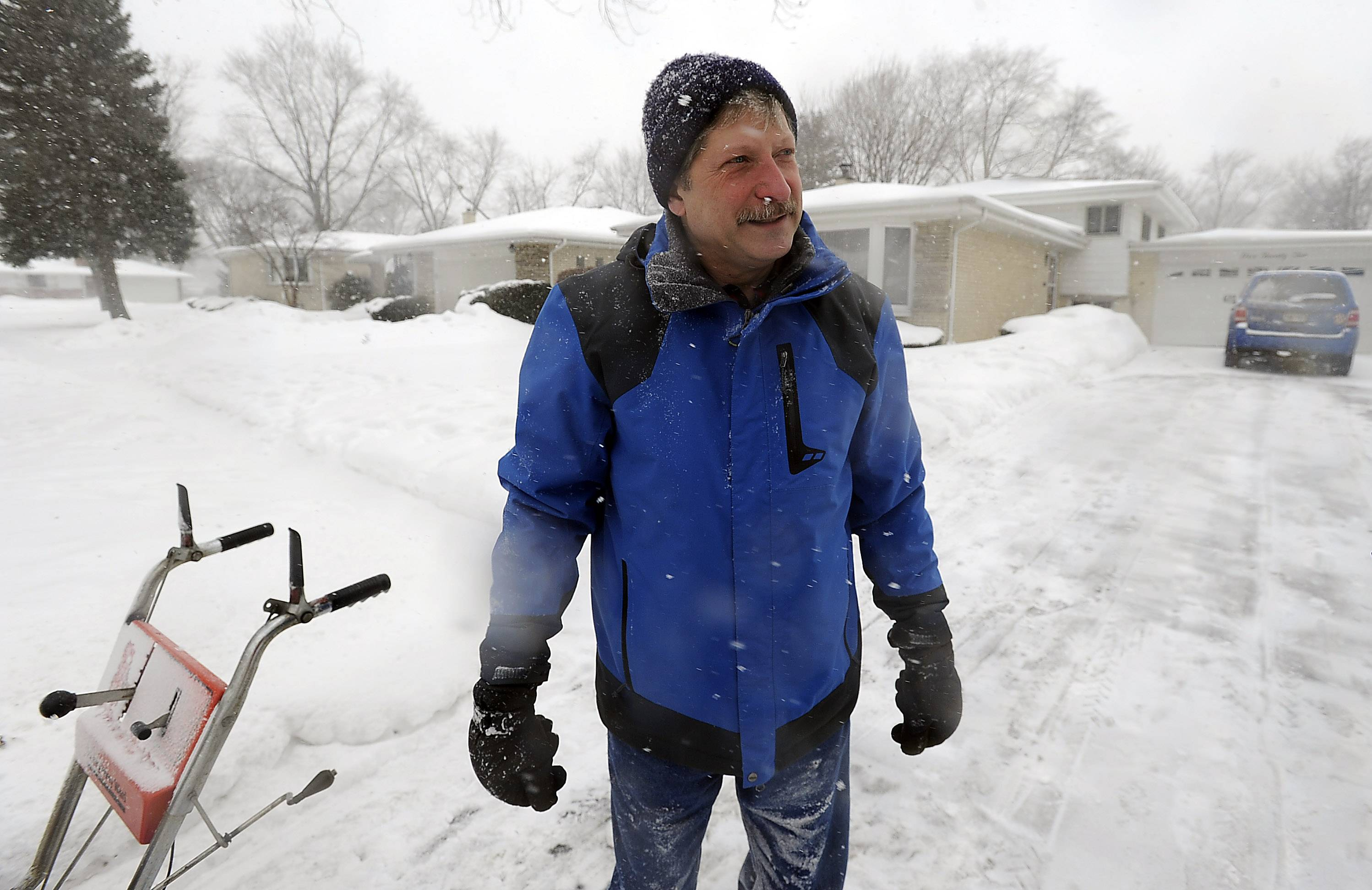 Without the single-digit temperatures, Monday's snowplowing effort seems relatively easy, says Jim Sieburg. The longtime Des Plaines resident, who turns 57 today, is a common sight in his neighborhood whenever it snows as he clears paths for several of his neighbors.