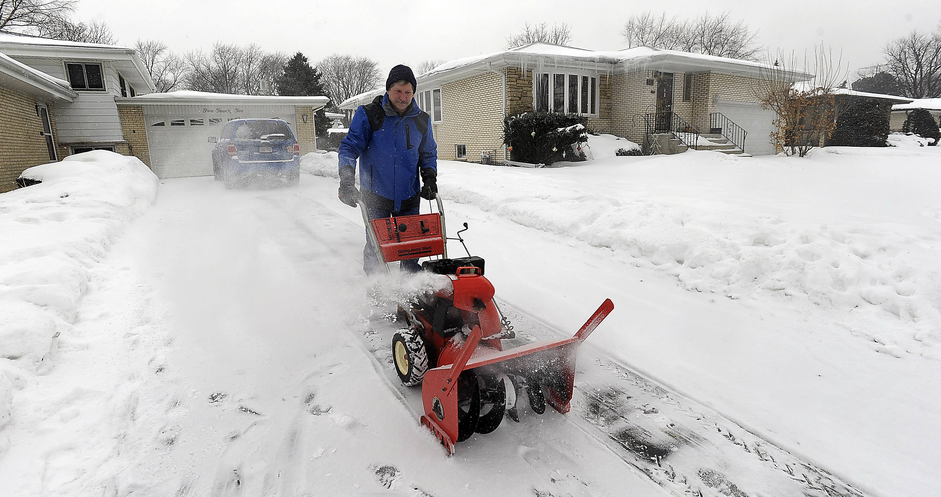 Clearing this driveway for an elderly widow in his Des Plaines neighborhood is just part of being a good neighbor, says Jim Sieburg, who has been snowplowing the driveways and sidewalks for many of his neighbors during the years.