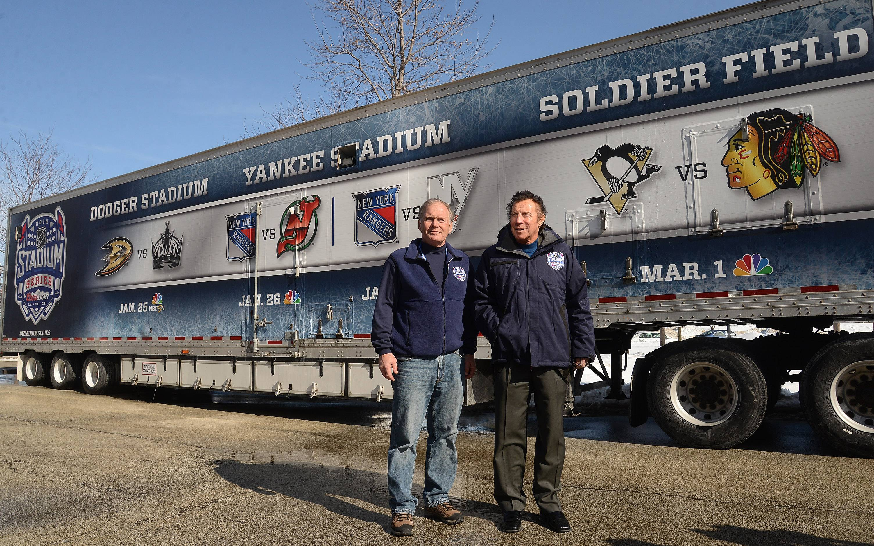 Dan Craig, NHL senior director of facilities operations, and Blackhawks ambassador and Hall of Famer Tony Esposito, right, were on hand to welcome the NHL Ice Truck to Soldier Field on Tuesday.