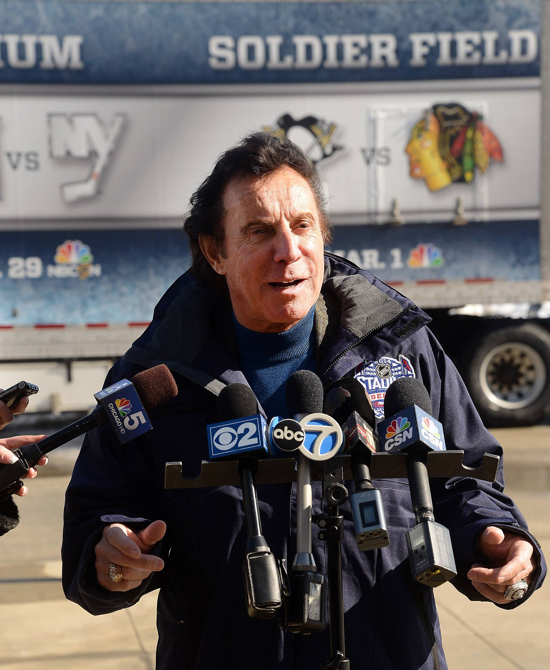 Blackhawks ambassador Tony Esposito talks with the media Tuesday about the excitement of the upcoming hockey game at Soldier Field.