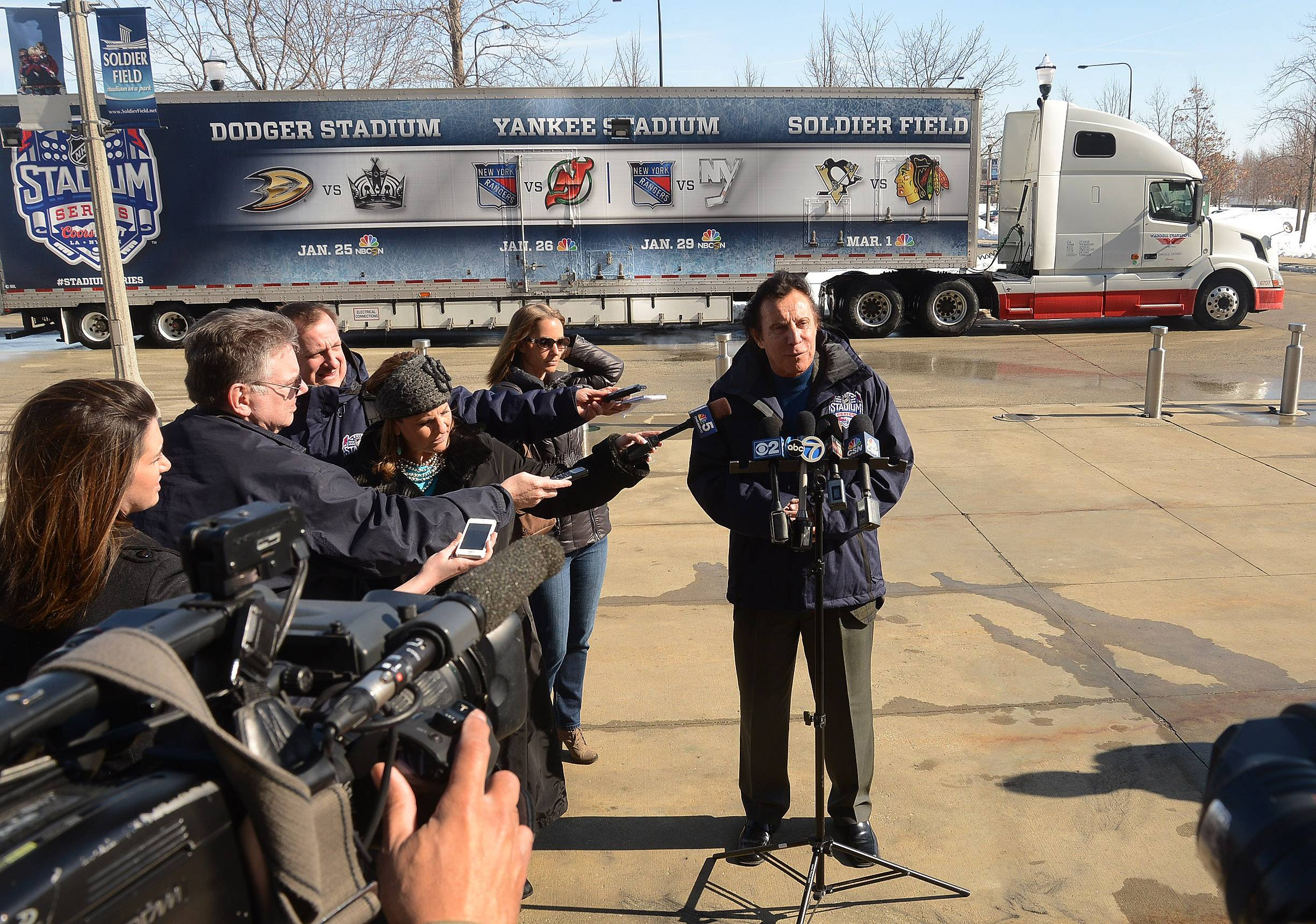 Blackhawks ambassador Tony Esposito talks with the media covering the arrival of the NHL Ice Truck at Soldier Field Tuesday.