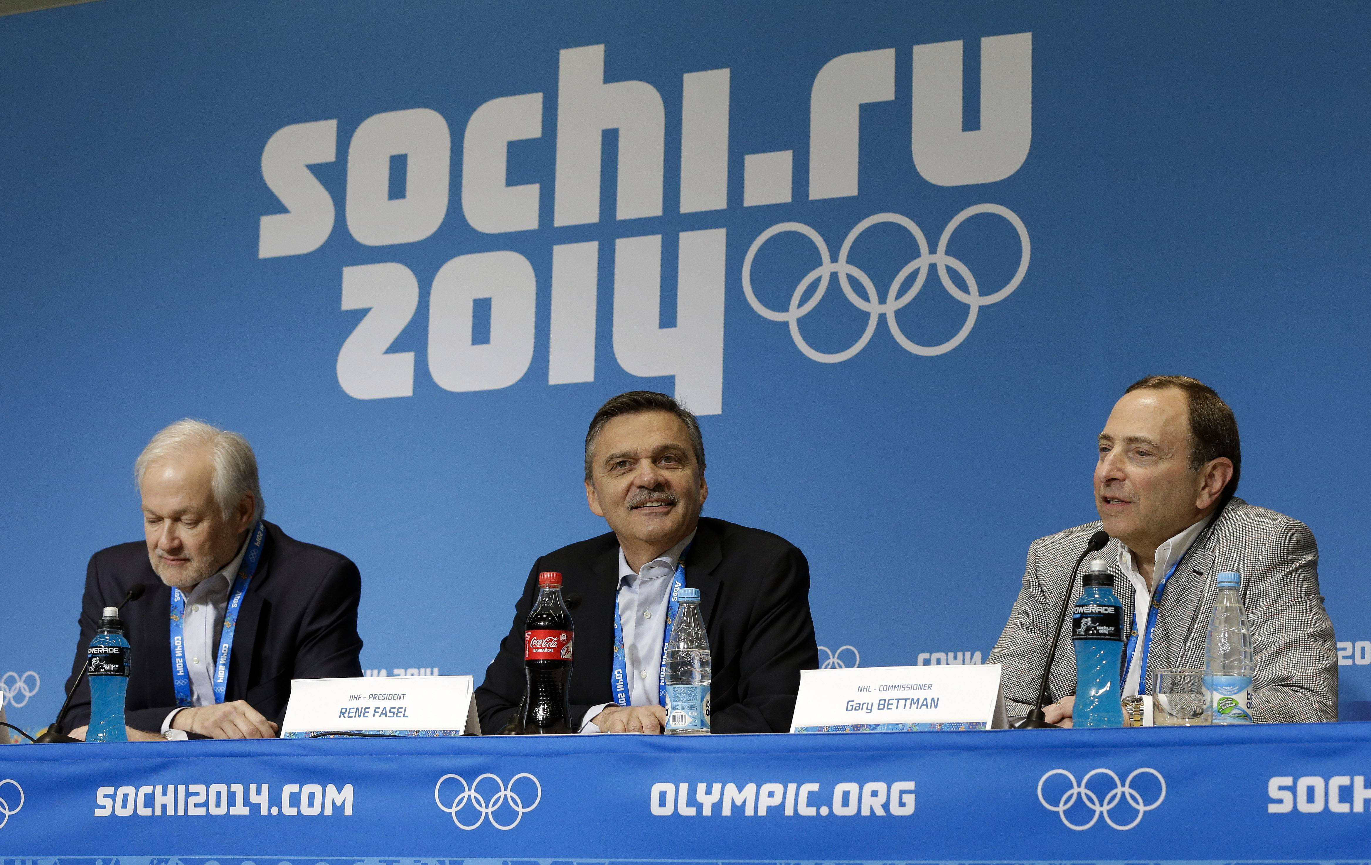 NHL Players' Association Executive Director Don Fehr, left, International Ice Hockey Federation President Rene Fasel, center, and NHL Commissioner Gary Bettman, right, answer questions at a news conference at the 2014 Winter Olympics, Tuesday, Feb. 18, 2014, in Sochi, Russia.