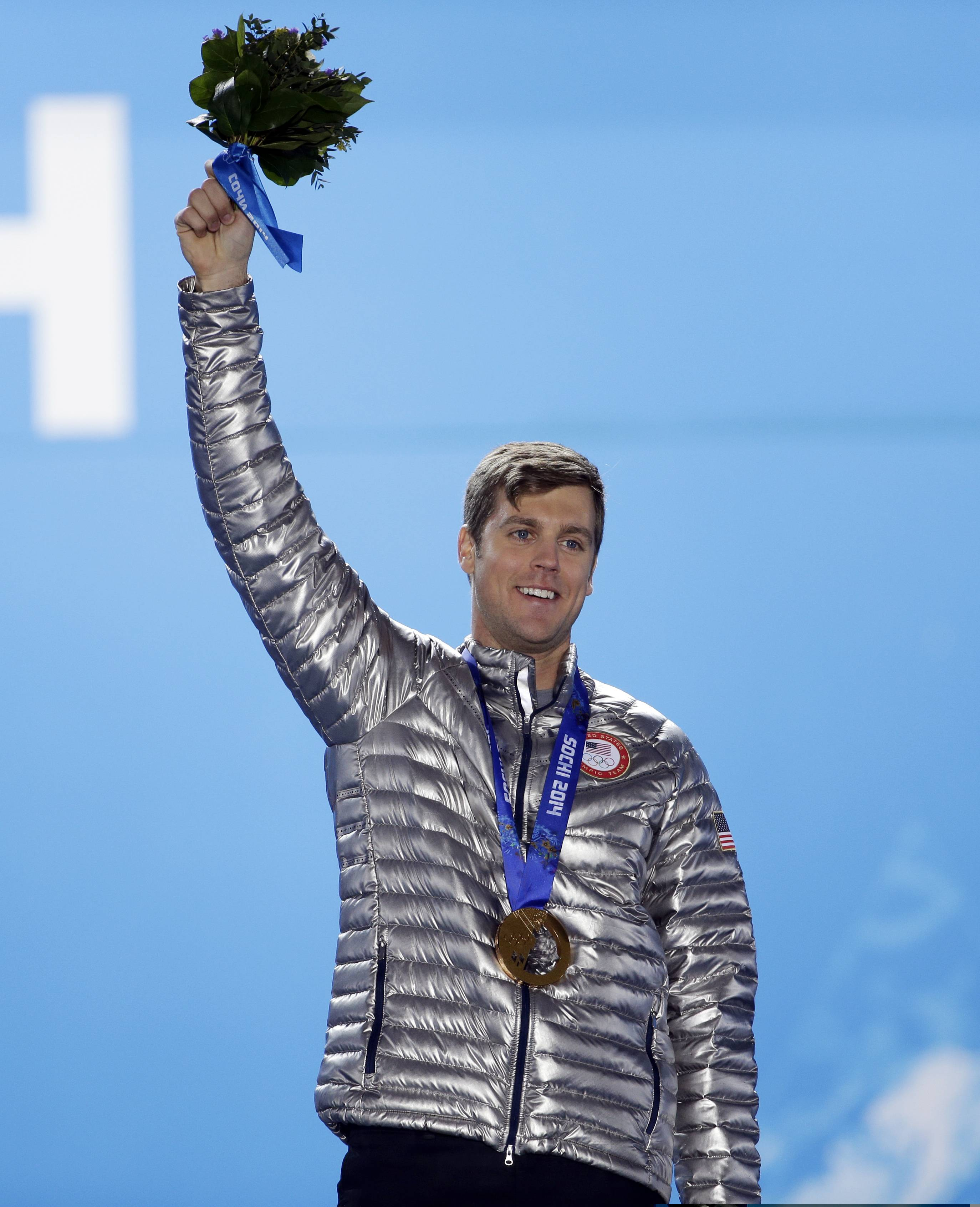 Men's snowboard cross bronze medalist Alex Deibold of the United States smiles during the medals ceremony .