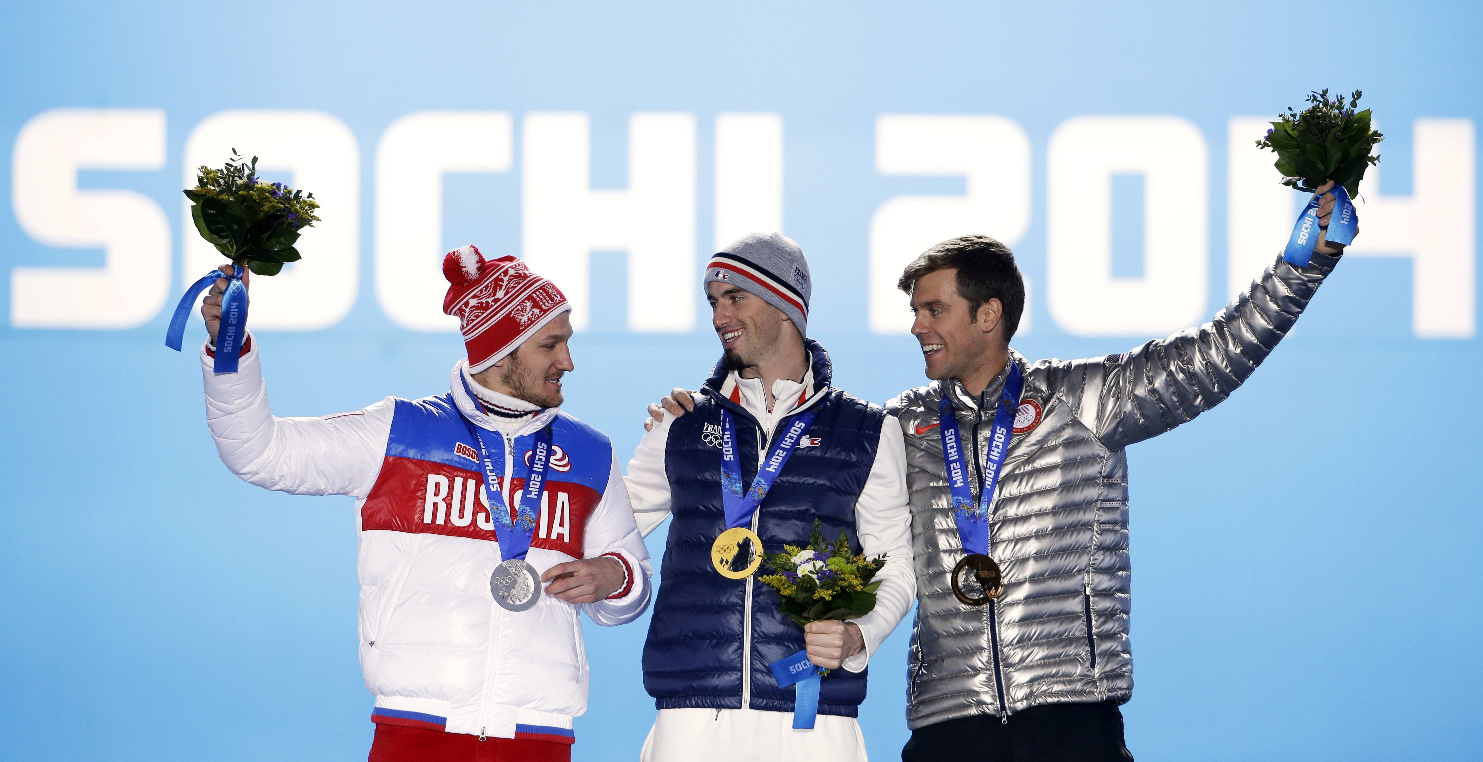 Men's snowboard cross medalists, from left, Russia's Nikolai Olyunin, silver, France's Pierre Vaultier, gold, and the United States' Alex Deibold, bronze, pose with their medals.