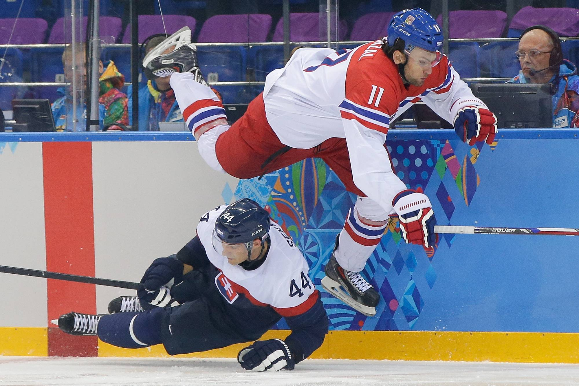 Czech Republic forward Martin Hanzal leaps over Slovakia defenseman Andrej Sekera during the third period.