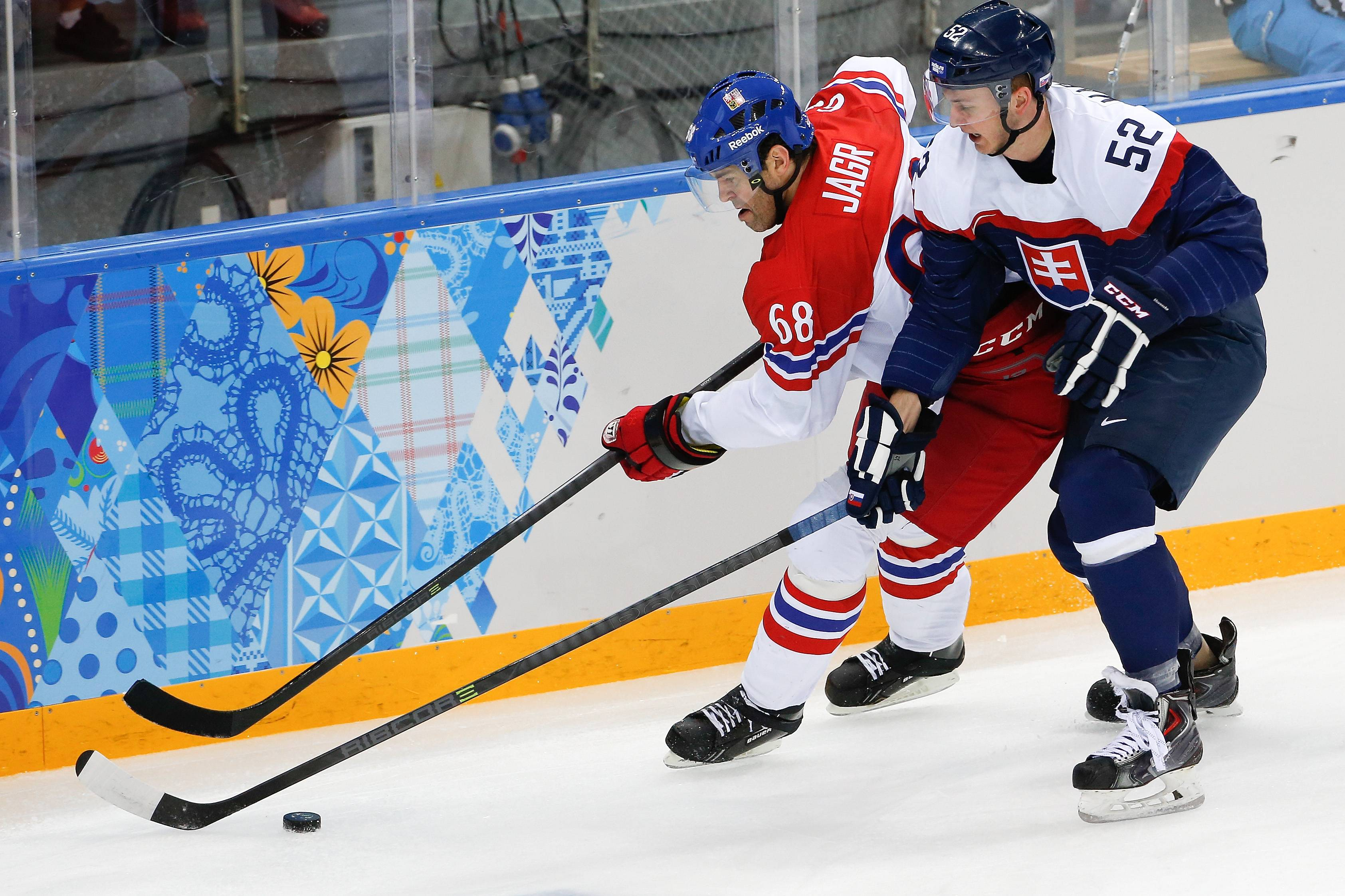 Czech Republic forward Jaromir Jagr and Slovakia defenseman Martin Marincin chase a loose puck during the first period.