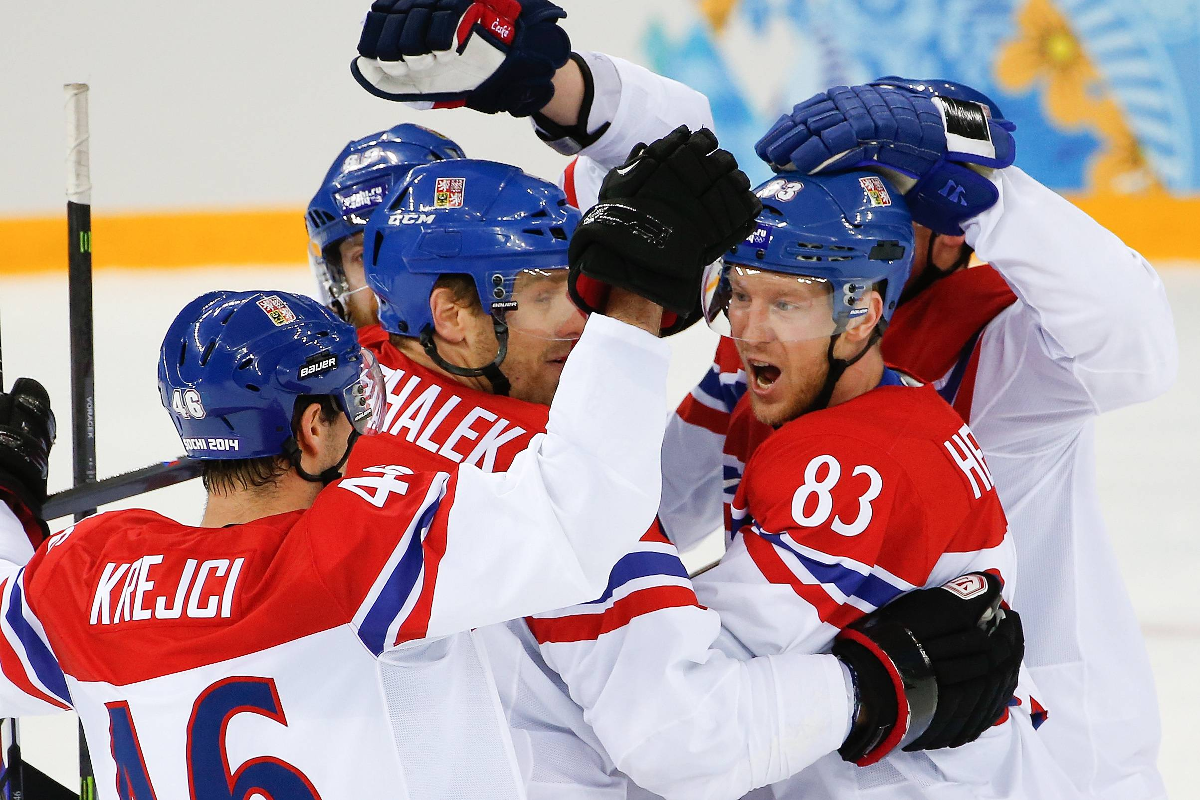 Czech Republic forward Ales Hemsky (83) celebrates his goal against Slovakia with his teammates during the first period.