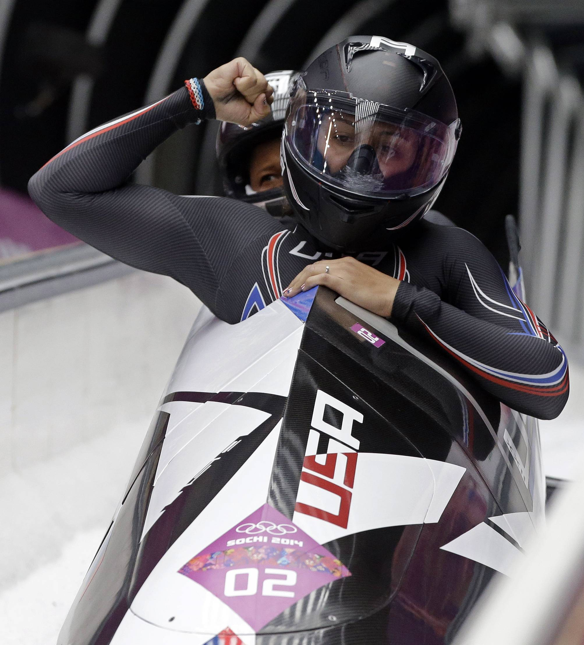 USA-1 teammates Elana Meyers and Lauryn Williams hold a comfortable lead over Canada-1 and USA-2 after two runs of women's Olympic bobsled.