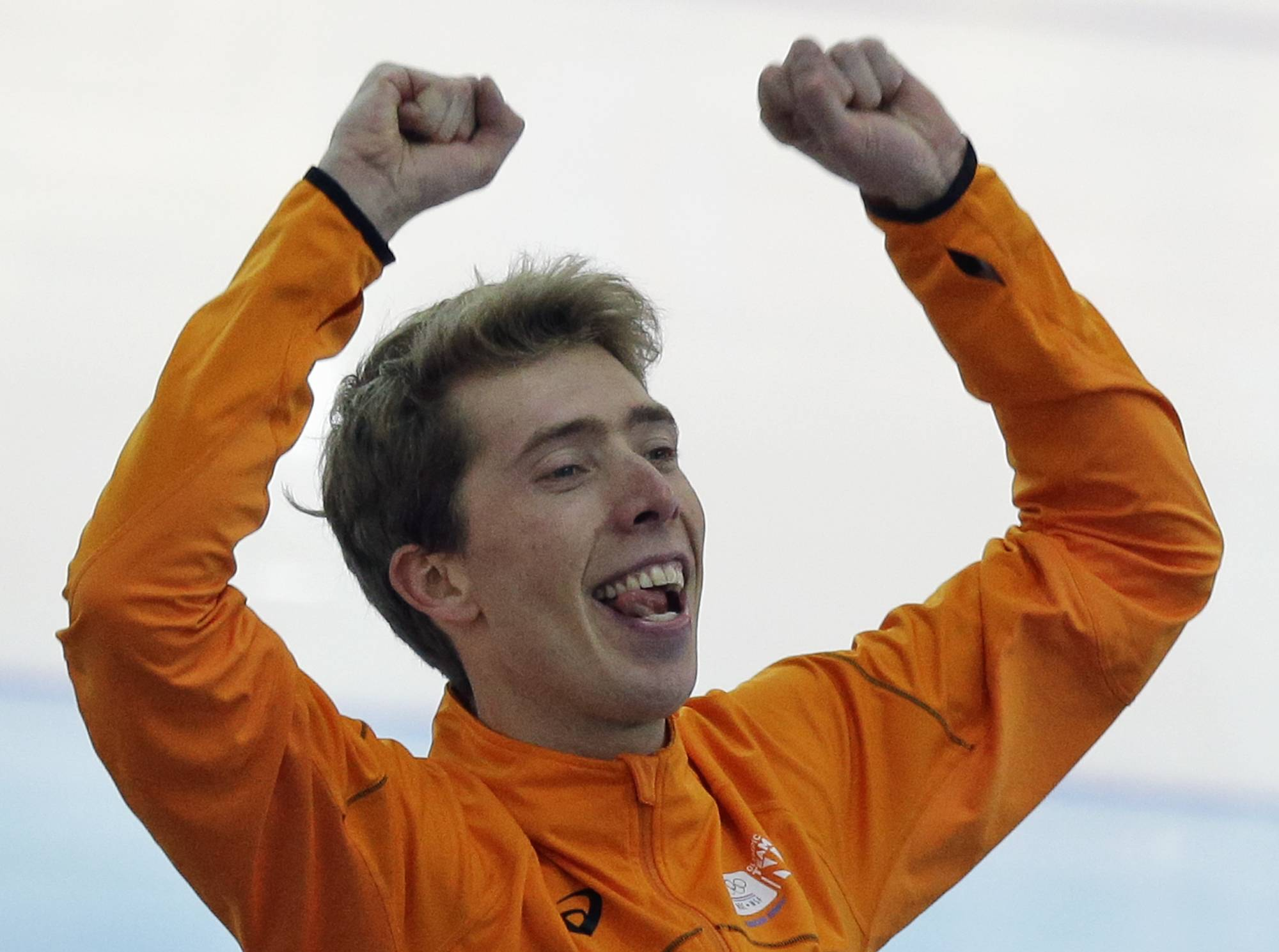 Gold medalist Jorrit Bergsma of the Netherlands celebrates after the final race in the men's 10,000-meter speedskating race at the Adler Arena Skating Center during the 2014 Winter Olympics in Sochi, Russia, Tuesday, Feb. 18, 2014.