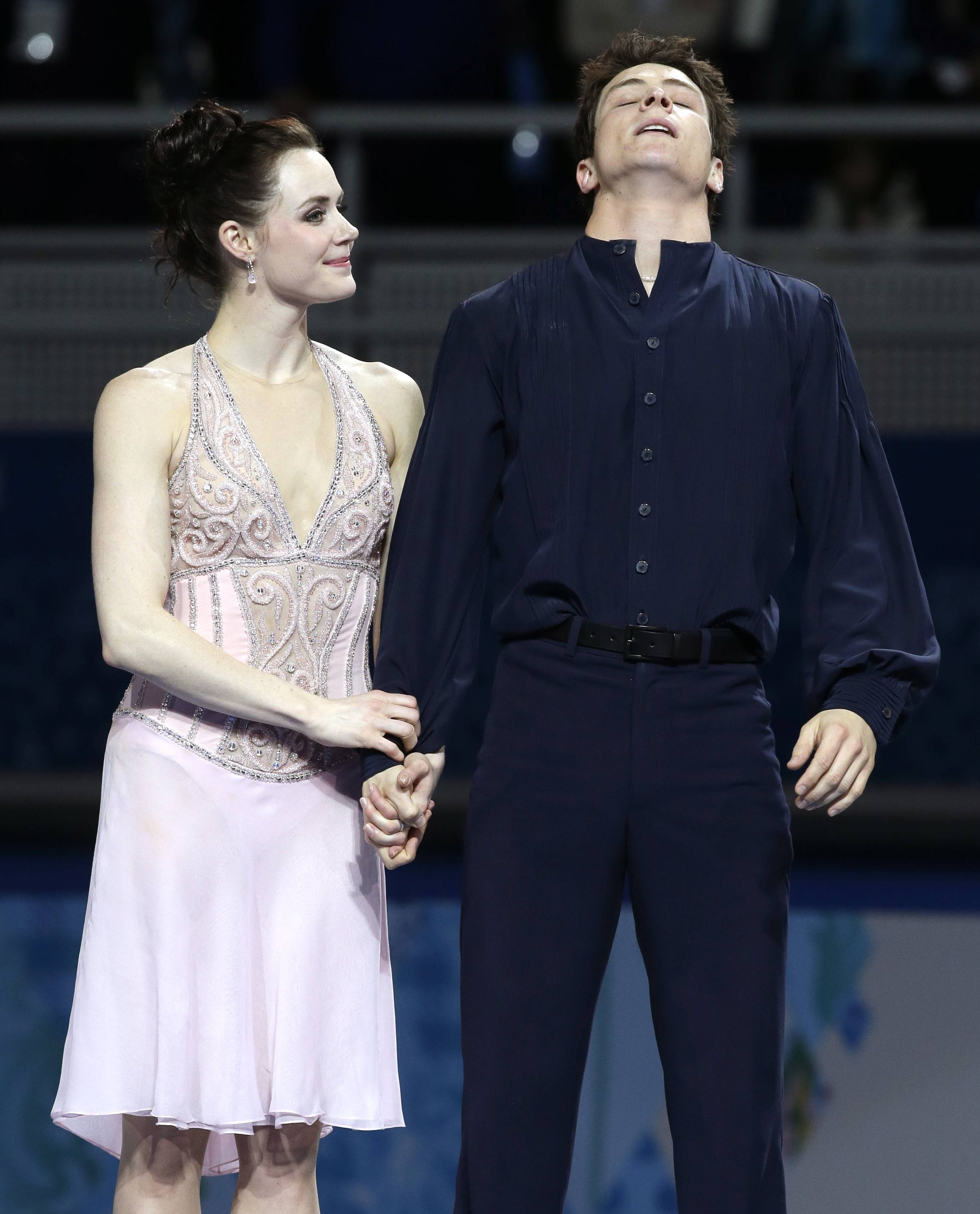 Tessa Virtue and Scott Moir of Canada react Monday after placing second in the ice dance free dance figure skating finals at the Iceberg Skating Palace during the 2014 Winter Olympics in Sochi, Russia.