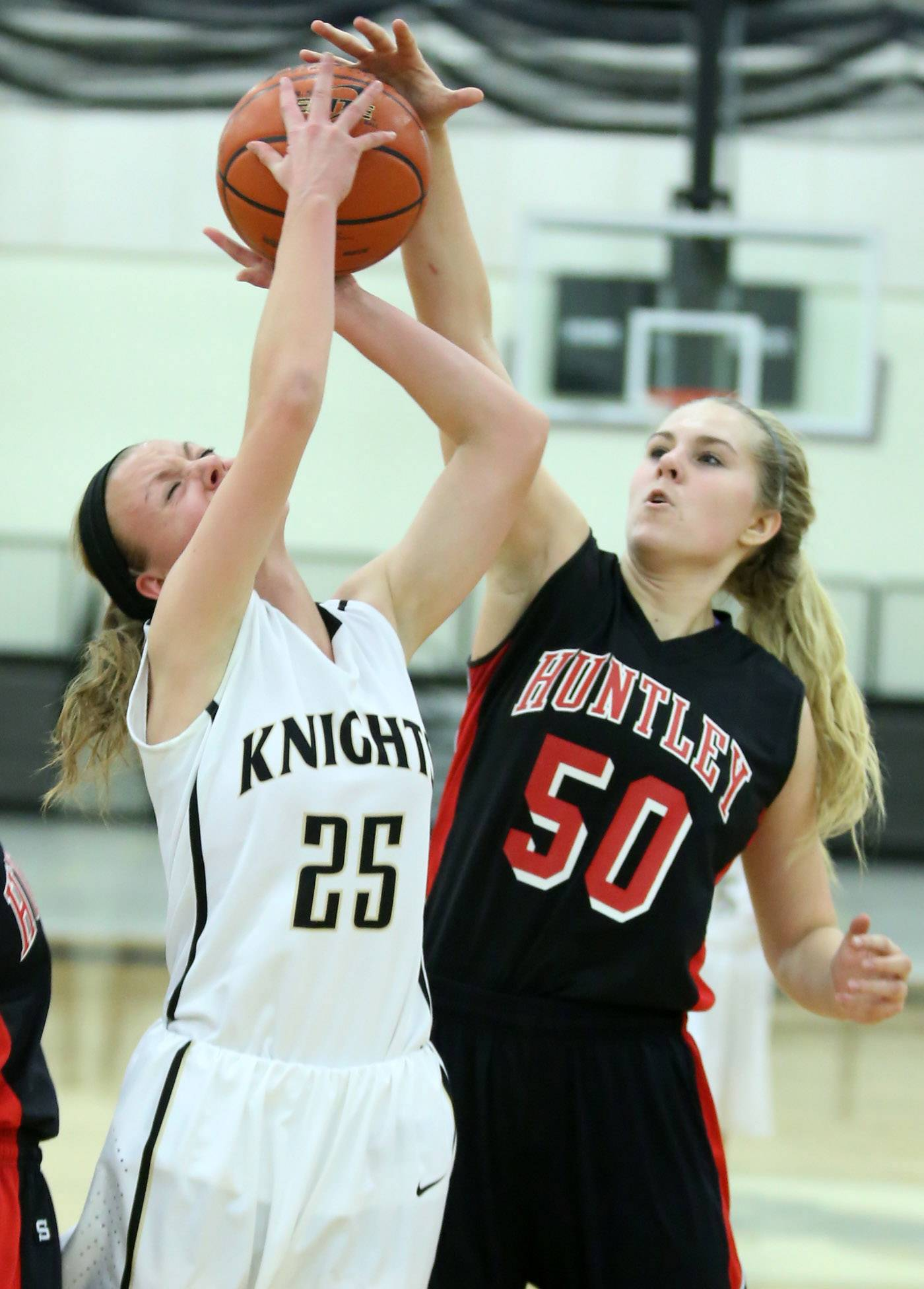 Grayslake North's Samantha Villwock shoots against Huntley defender Ali Andrews Friday at Grayslake North.
