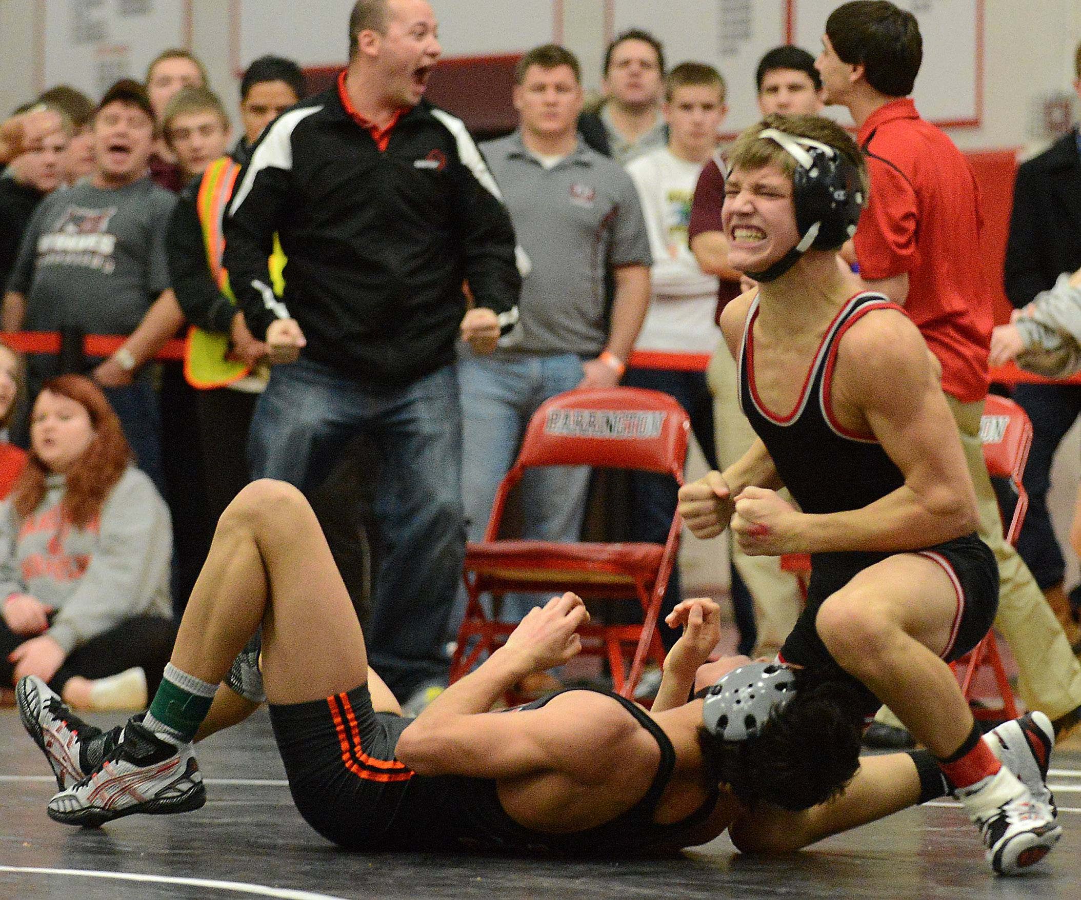 Barrington's Mitch Stathakis celebrates his 106-pound win Saturday at the Barrington sectional wrestling meet.