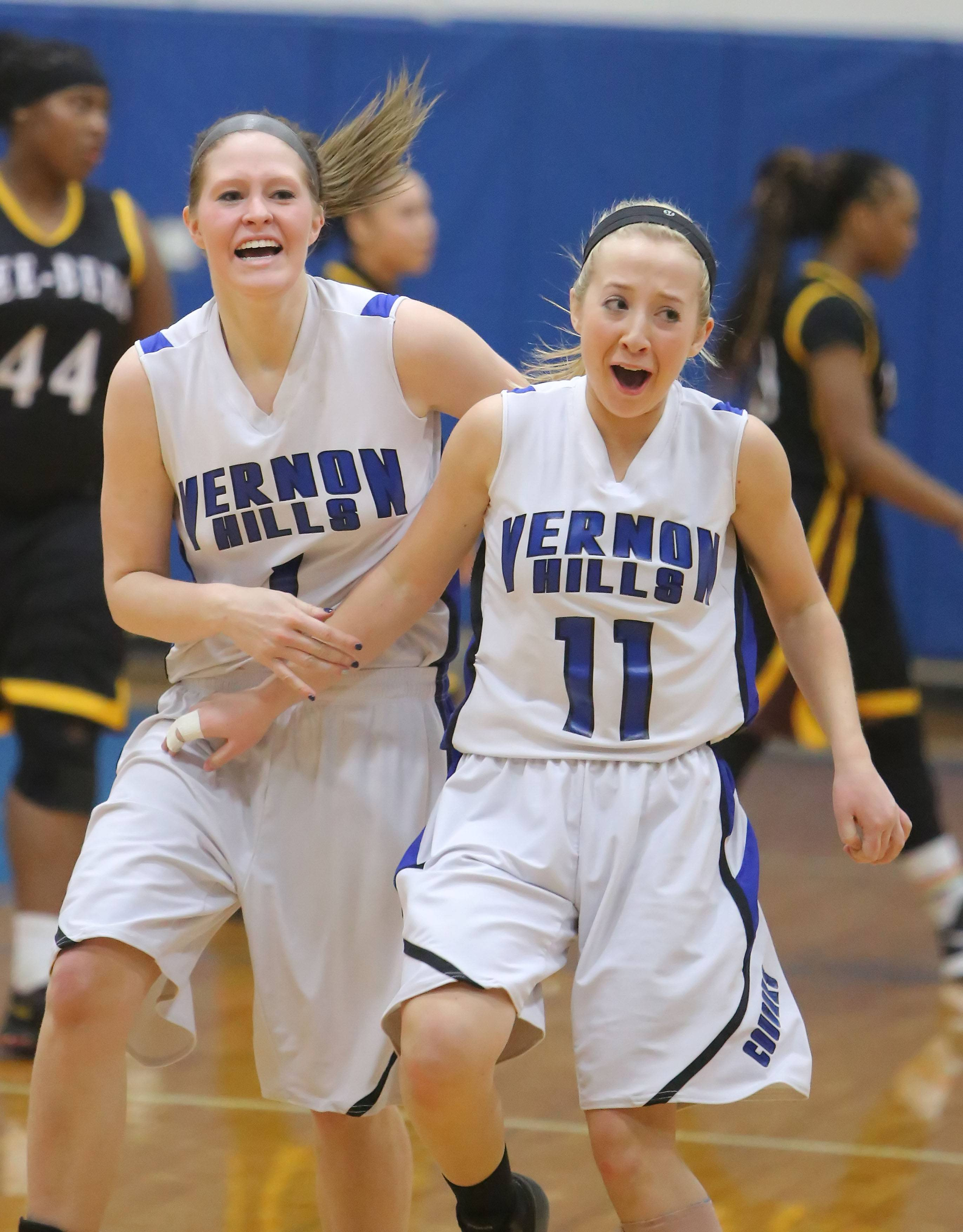 Vernon Hills' Sydney Smith, left, and Haley Lieberman celebrate after beating Zion-Benton to win the North Suburban Conference championship Wednesday night in Vernon Hills.