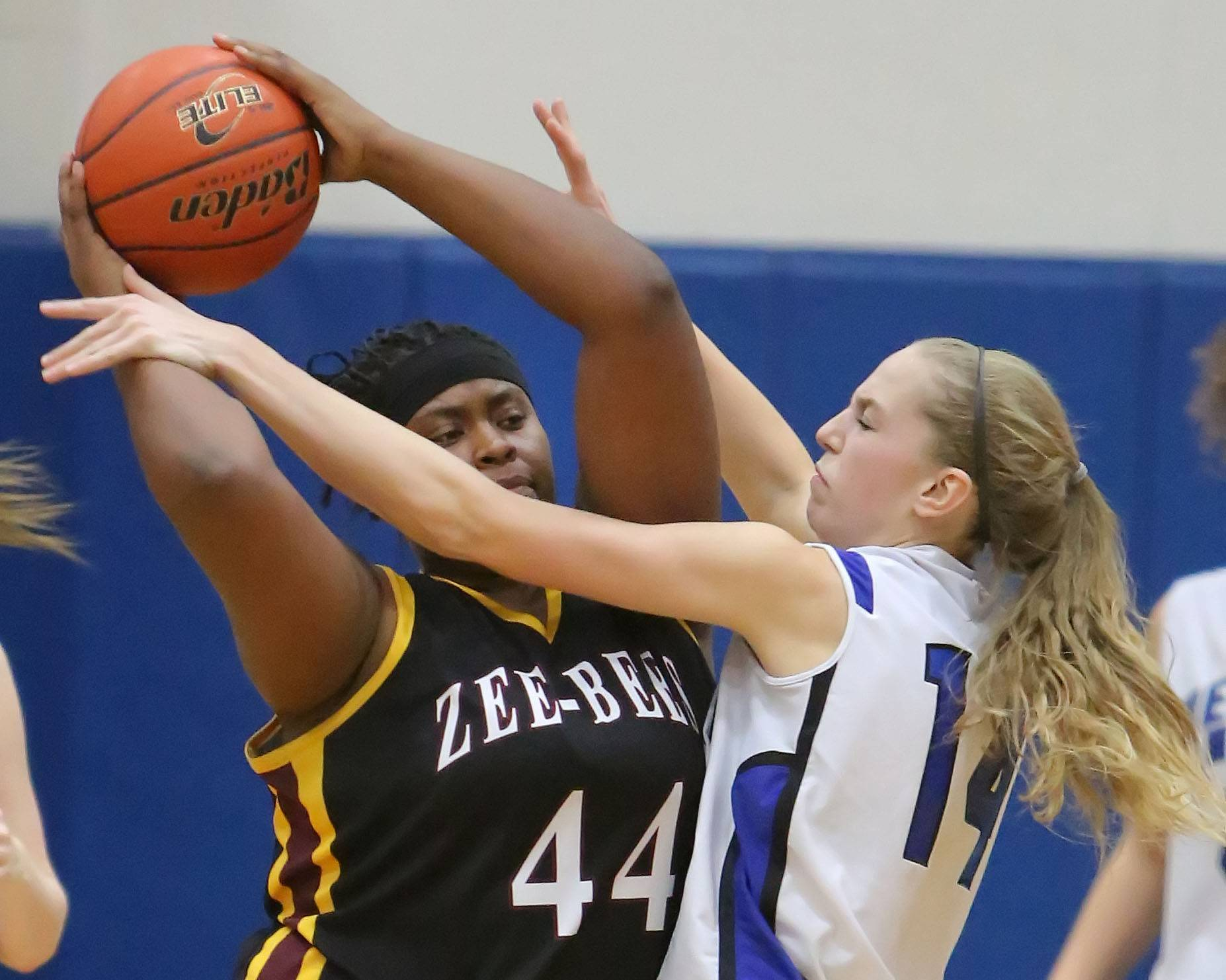 Vernon Hills' Kasey Firnbach, right defends against Zion-Benton's Mia Yarbrough during the North Suburban Conference championship game Wednesday night in Vernon Hills.