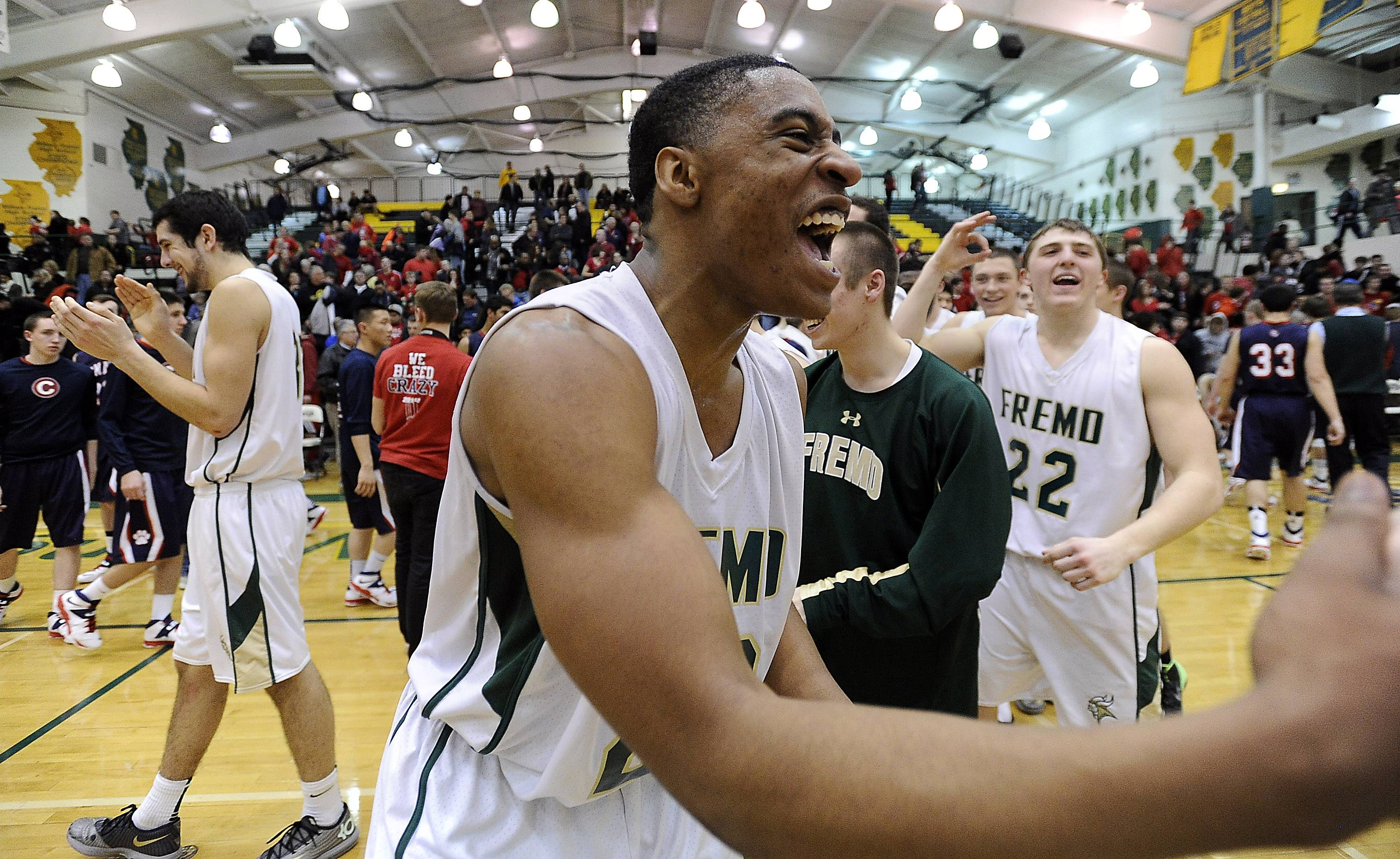 Fremd's Xavier Williams (23) celebrates with his teammates after beating Conant for a share of the MSL West title Friday at Fremd.