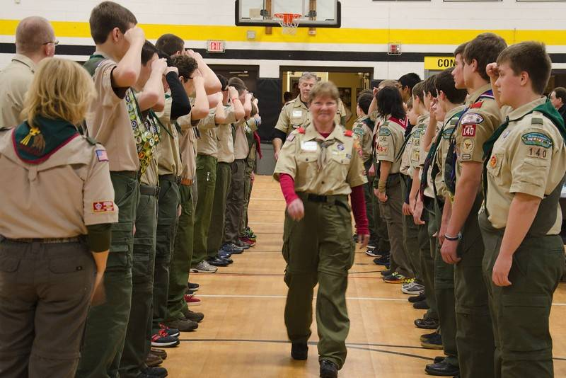 Former Troop 140 Scoutmasters Corinne Aguyao Wilson, front, and Mike Sarlitto, back, are saluted by Scouts from the troop as they enter a special Golden Anniversary Court of Honor event for the troop.
