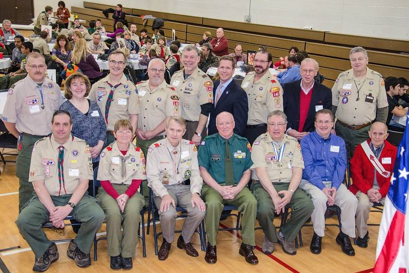 Boy Scout Troop 140 in Buffalo Grove recently celebrated its 57th anniversary at a Court of Honor event. Scoutmasters from the past five decades were recognized. Pictured in front from left are Tim Meinholz, Corinne Aguyao Wilson, Scott Brumund, Jack Knight, Luciano Nuccio, Rick Giebelhausen (son of deceased scoutmaster Chuck Giebelhausen), Edward Jost; and in back from left Rodney Brandon, Yvonne Kristiansen (daughter of deceased scoutmaster Paul Soucy), Tim Wziontka, Eric Galla, Mike Sarlitto, former U.S. Rep. Bob Dold, Edward Diamond, Chuck Moodhe and Robert M. Walton.