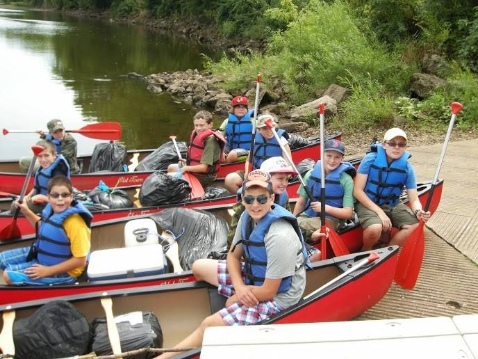 Scouts from Troop 140 take a break during a canoe trip on the Wisconsin River. Troop 140 provides its members with opportunities to travel and experience the outdoors.