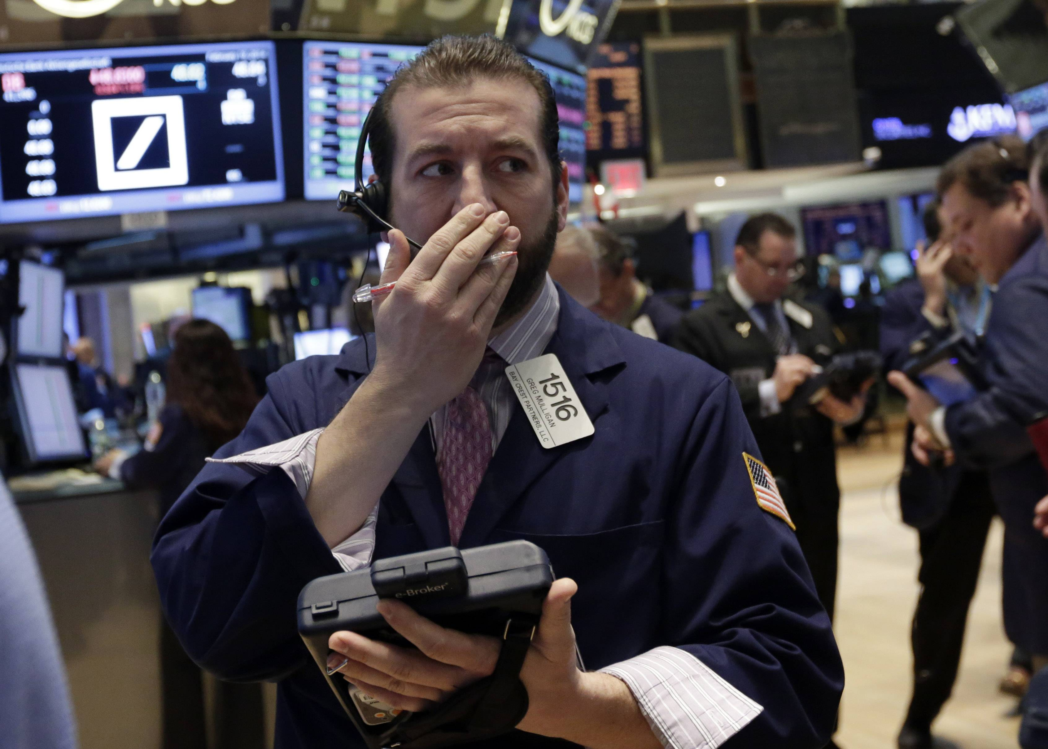 Stocks fell Wednesday, after the Standard & Poor's 500 Index rose to within one point of a record close, as the International Monetary Fund warned of risks to global growth and Federal Reserve indicated stimulus cuts will likely continue.
