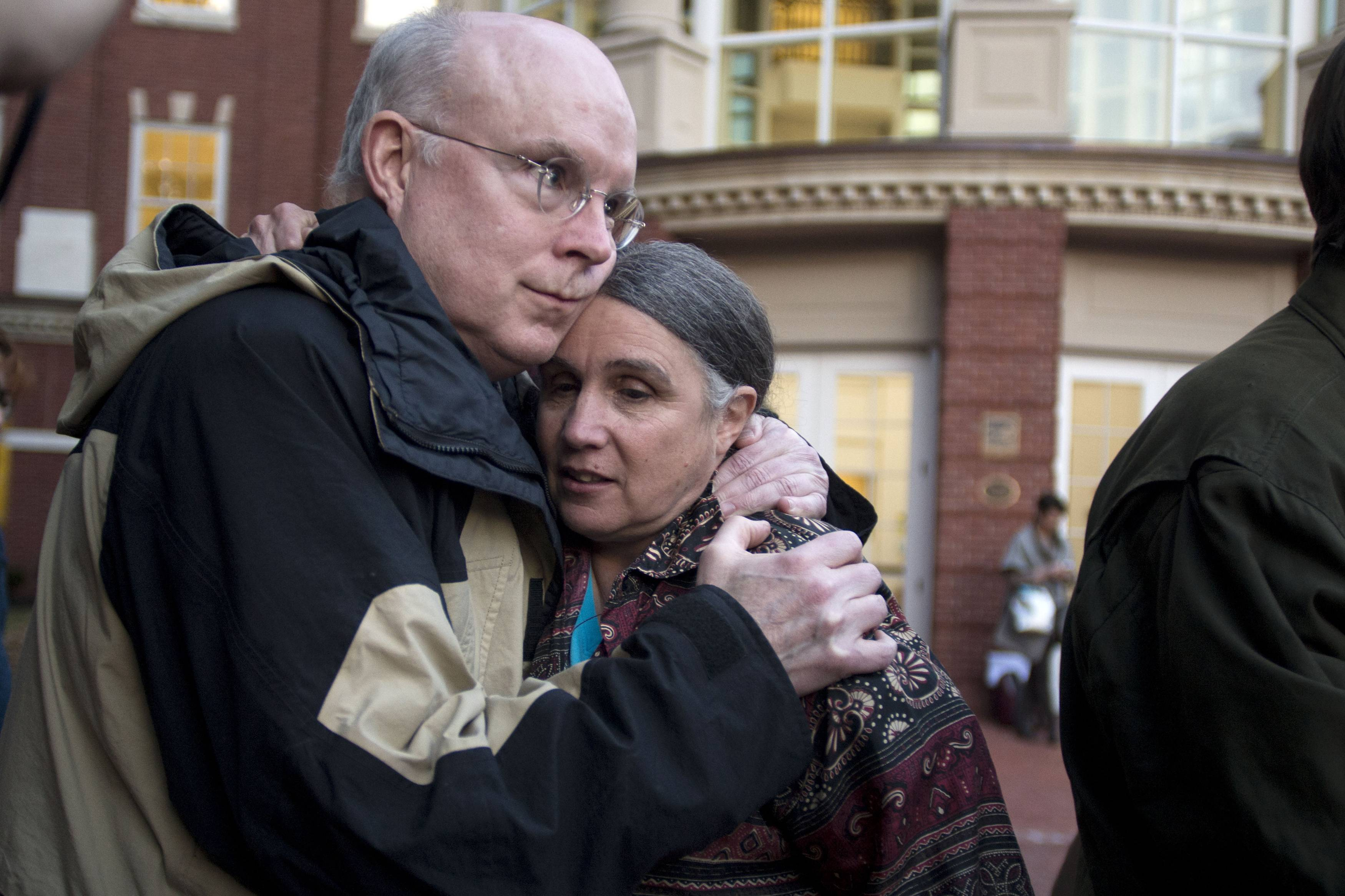 William Quigley and Michele Naar-Obed hug outside the Federal Courthouse after Naar-Obed's husband, Greg Boertje-Obed and two others were sentenced for the role they played in a July 2012 break-in at the Y-12 National Security Complex in Knoxville, Tenn., Tuesday, Feb. 18, 2014.