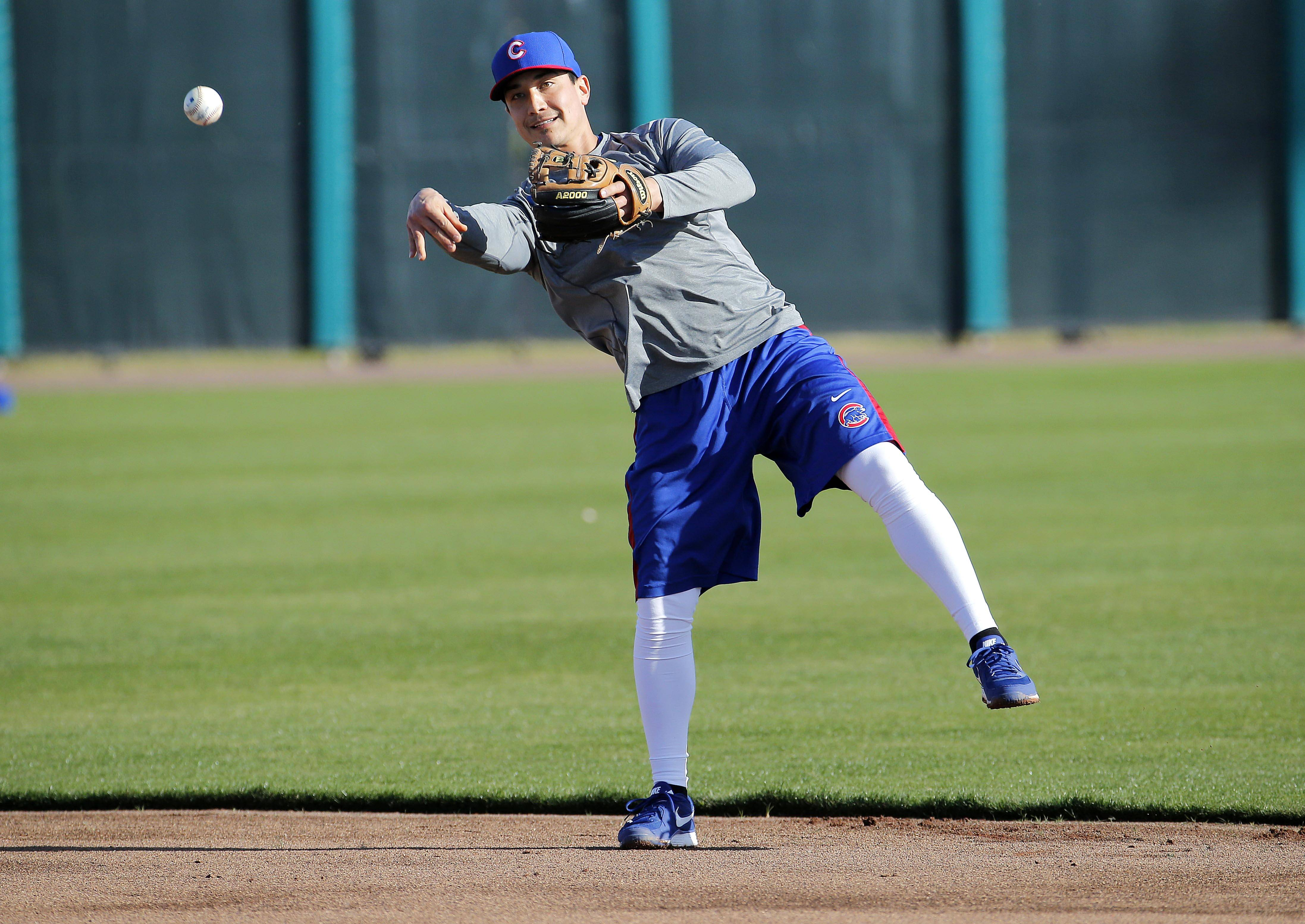 Cubs second baseman Darwin Barney throws before the team's first spring-training practice, Friday, Feb. 14, 2014, in Peoria, Ariz. (AP Photo/Matt York)