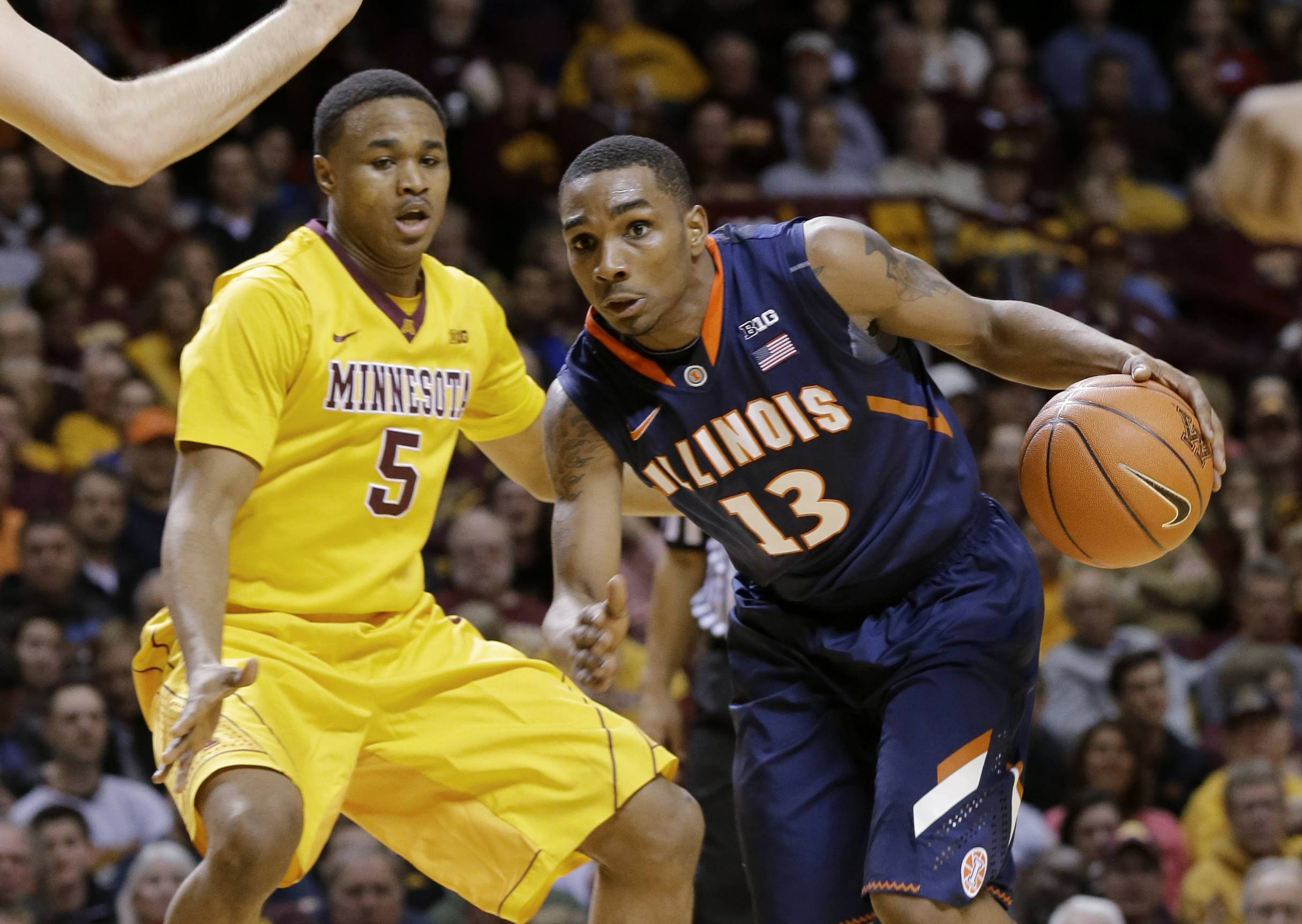 Illinois guard Tracy Abrams (13) drives against Minnesota guard Daquein McNeil (5) during the first half of an NCAA college basketball game in Minneapolis, Wednesday, Feb. 19, 2014. (AP Photo/Ann Heisenfelt)