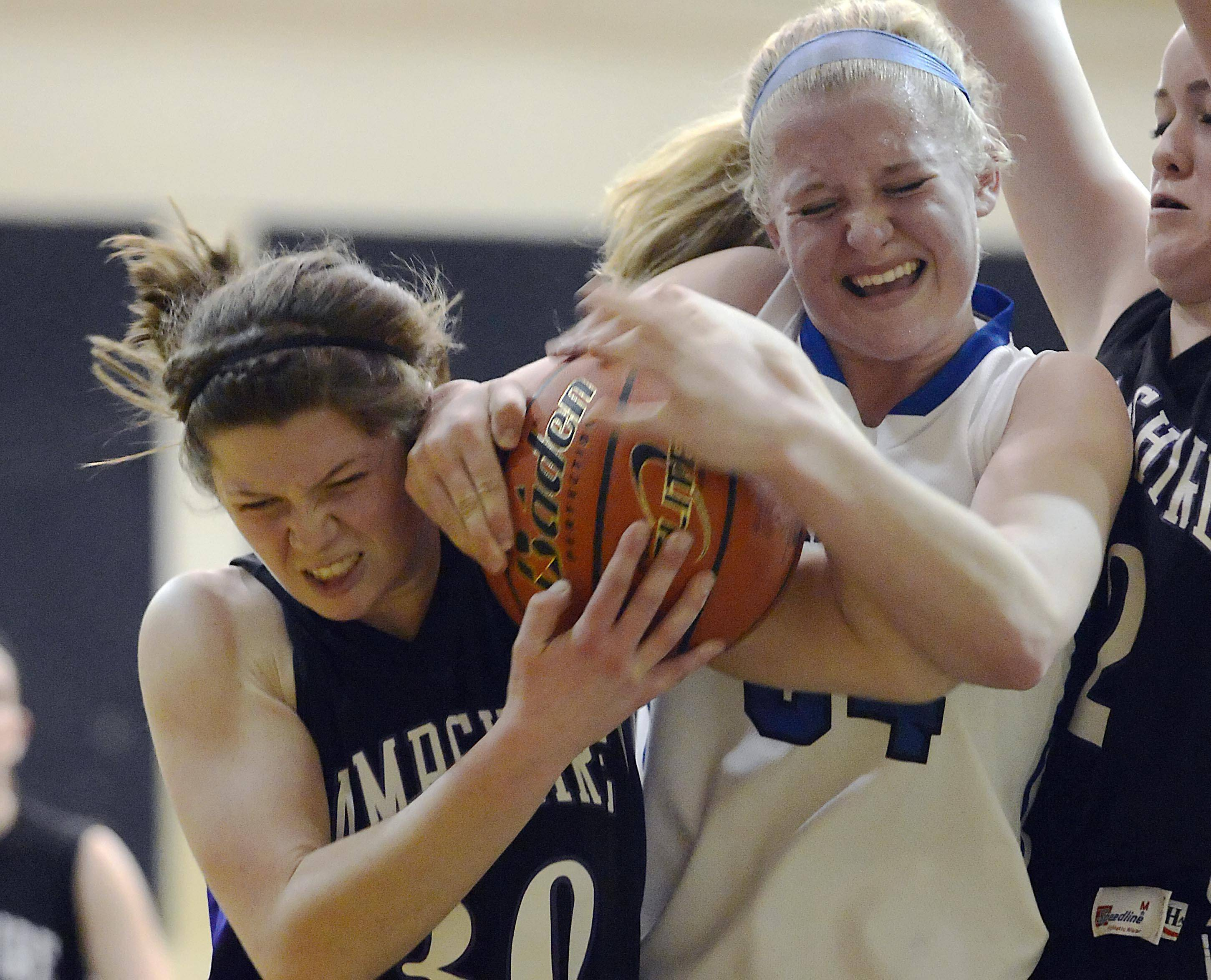 Burlington Central's Samantha Pryor and Hampshire's Tricia Dumoulin fight for the ball Wednesday at the Aurora Central Catholic regional semifinal.