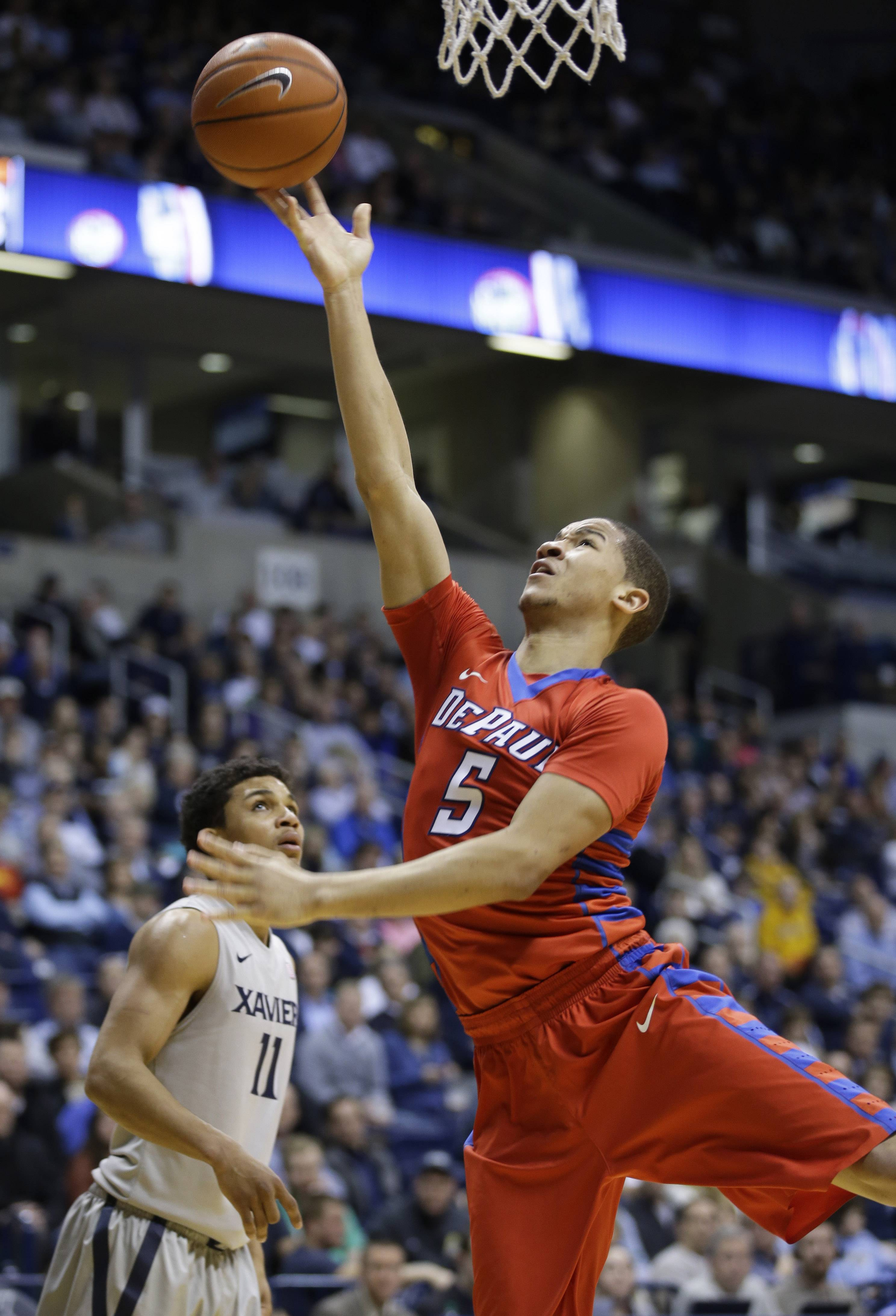 DePaul guard Billy Garrett Jr. (5) shoots against Xavier guard Dee Davis (11) in the second half of an NCAA college basketball game, Wednesday, Feb. 19, 2014, in Cincinnati. Xavier won 83-64. (AP Photo/Al Behrman)