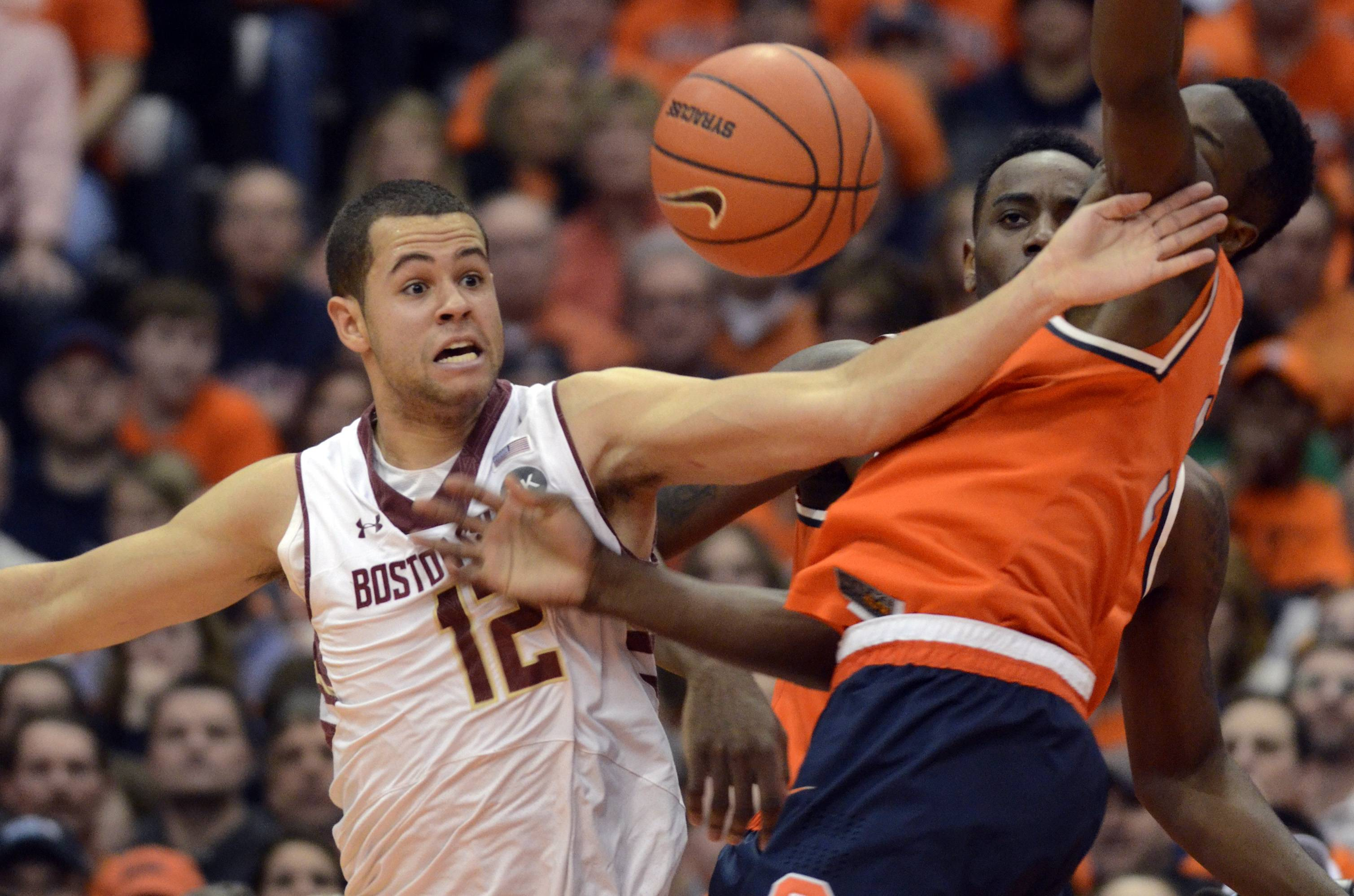 Boston College's Ryan Anderson, left, battles Syracuse's Jerami Grant for a loose ball during the first half of an NCAA college basketball game in Syracuse, N.Y., Wednesday, Feb. 19, 2014. (AP Photo/Kevin Rivoli)