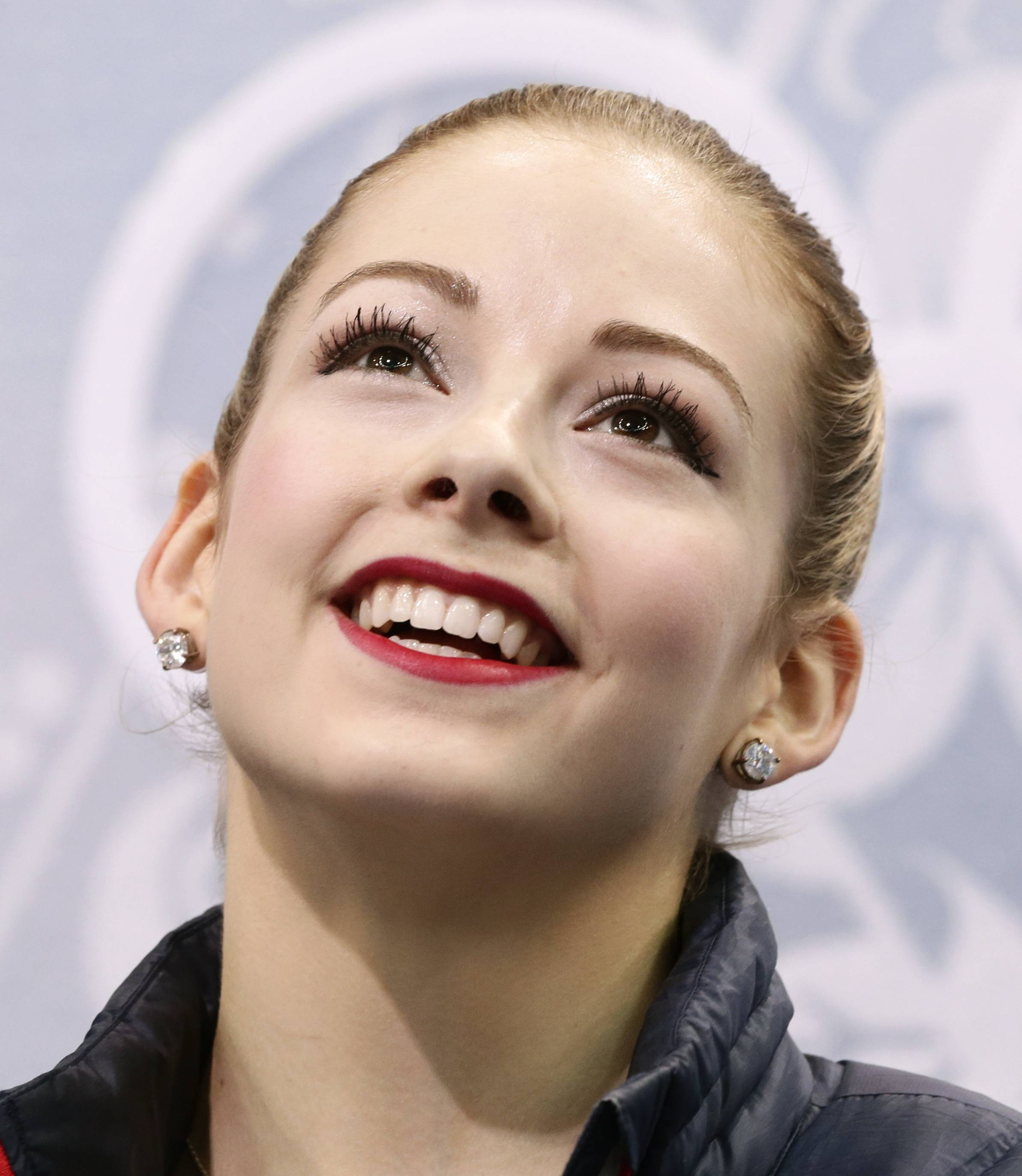 Gracie Gold of the United States waits in the results area after completing her routine in the women's short program figure skating competition at the Iceberg Skating Palace during the 2014 Winter Olympics, Wednesday, Feb. 19, 2014, in Sochi, Russia. (AP Photo/Bernat Armangue)
