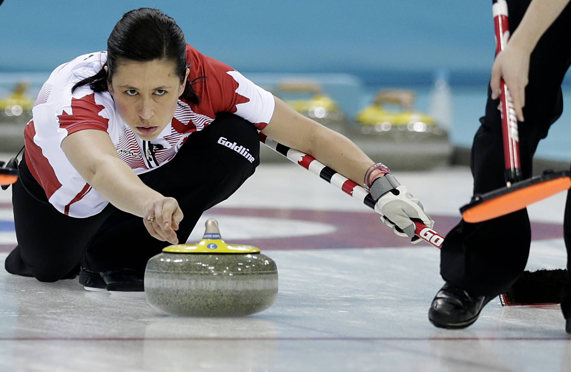 Canada's Jill Officer releases the rock during the women's curling semifinal game against Britain at the 2014 Winter Olympics, Wednesday, Feb. 19, 2014, in Sochi, Russia.