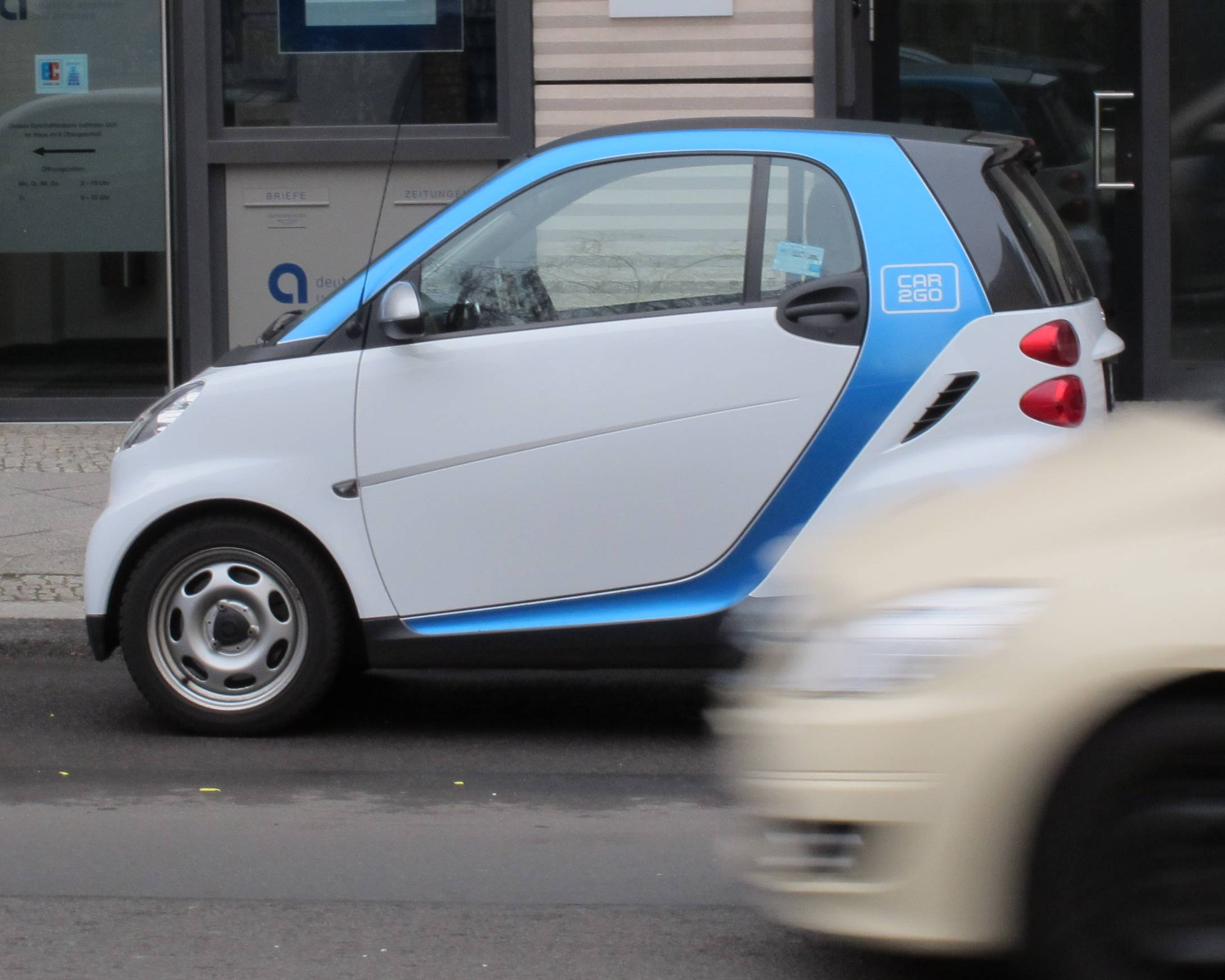 A Car2Go vehicle is parked in central Berlin Wednesday. The service, operated by Mercedes-Benz and Smart car manufacturer Daimler launched a new intercity service recently.