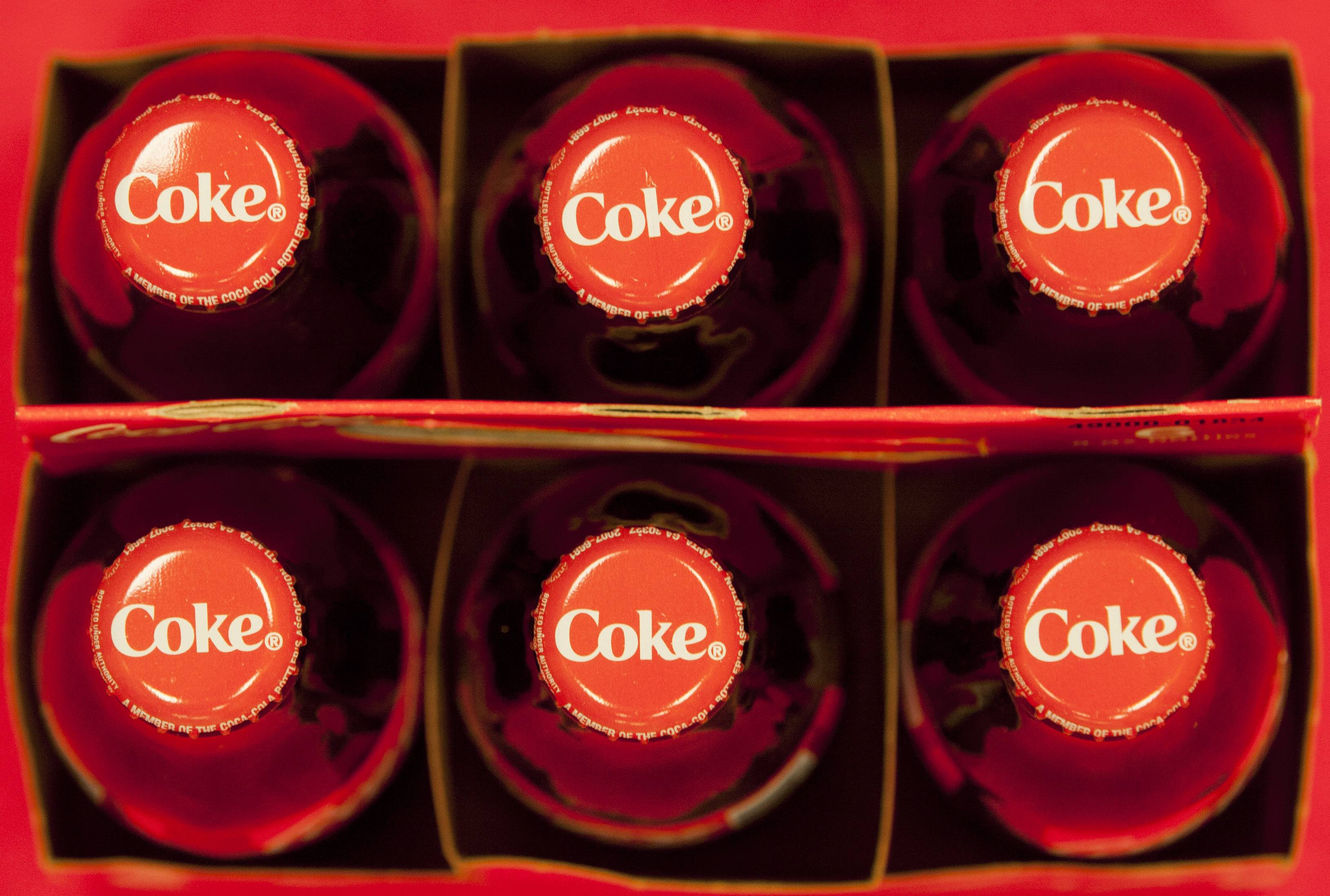 Coca-Cola says its profit fell in the fourth quarter as it sold less soda in North America.