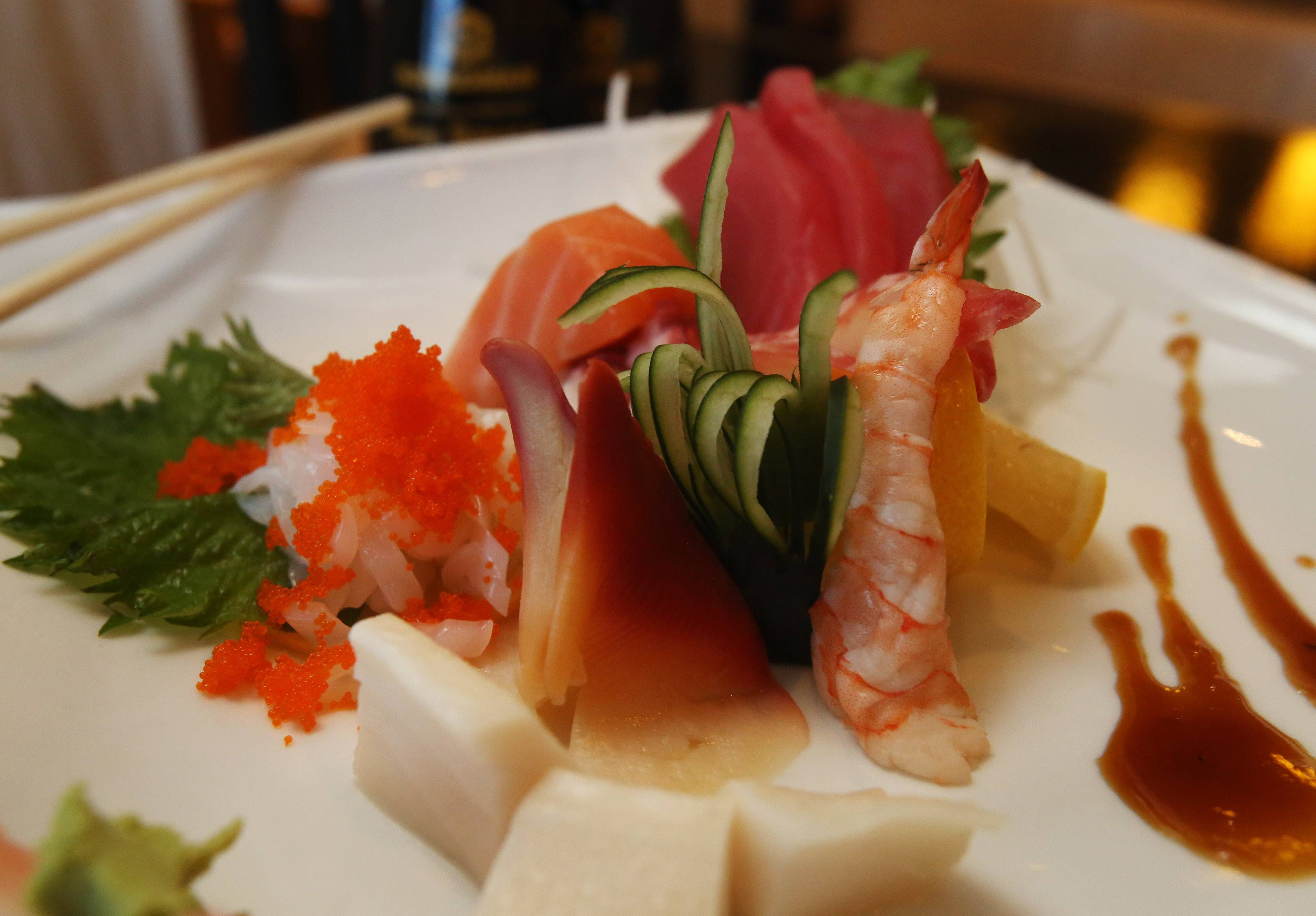 Hayashi's sashimi dinner highlights several varieties of seafood and shredded radish.