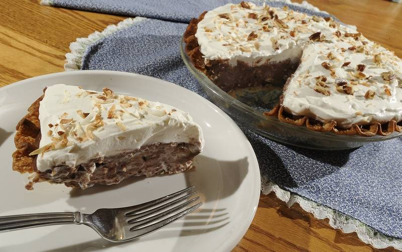 generous layer of whipped cream tops German chocolate pie made with ...