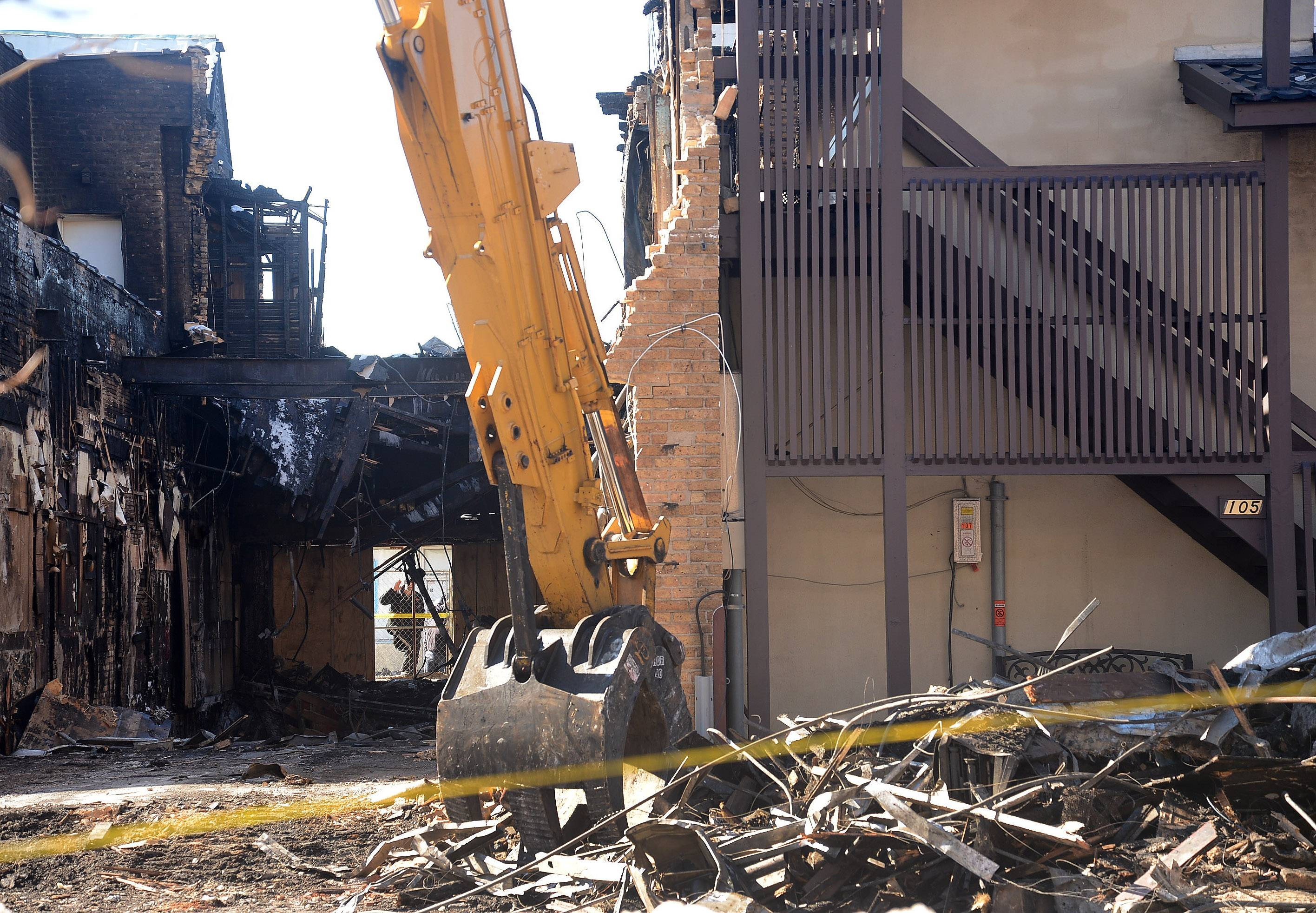 Demolition of the fire-ravaged historic building at 105 S. Main St. in downtown Mount Prospect continues this week. Village officials say what happens next with the site is in the hands of its owner and insurance adjusters.