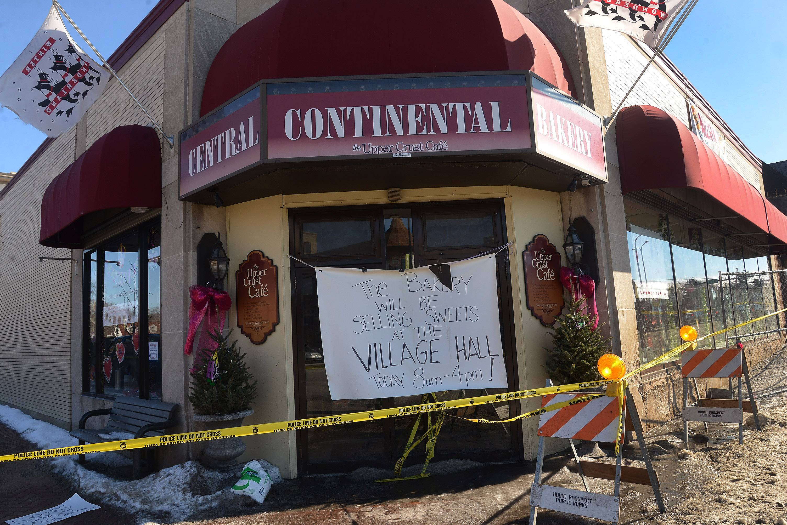 A sign in front of Central Continental Bakery in Mount Prospect directs customers to village hall, which the bakery has used to sell its good since a Feb. 9 fire damaged its location in the village's downtown.
