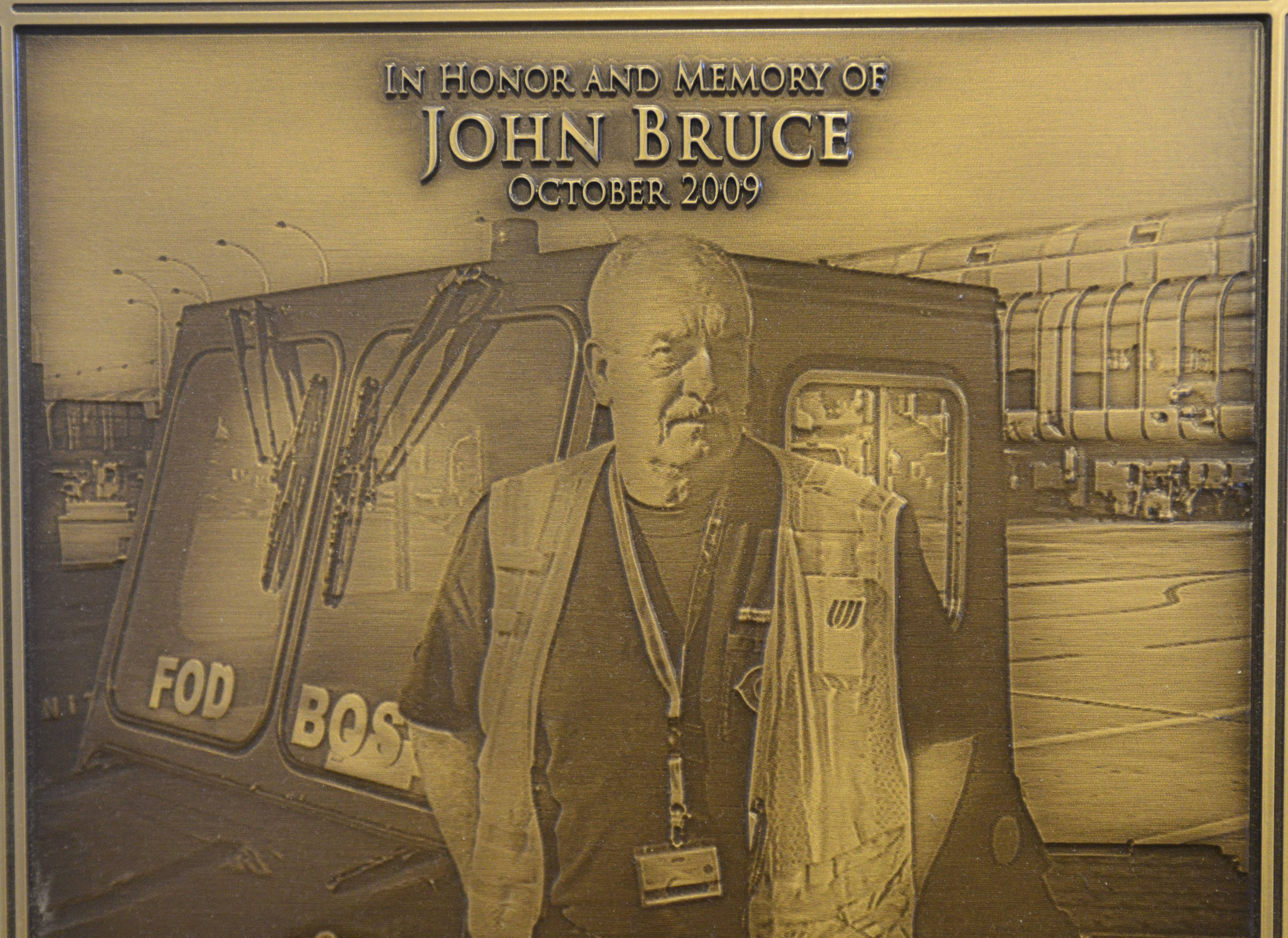 The family of the late John Bruce of Arlington Heights won a $6.65 million judgment in its wrongful death suit against CAV International. The 64-year old United Airlines employee, shown in this memorial plaque which was presented to the family by United Airlines, died in Kuwait in October, 2009, while unloading cargo for the US military.