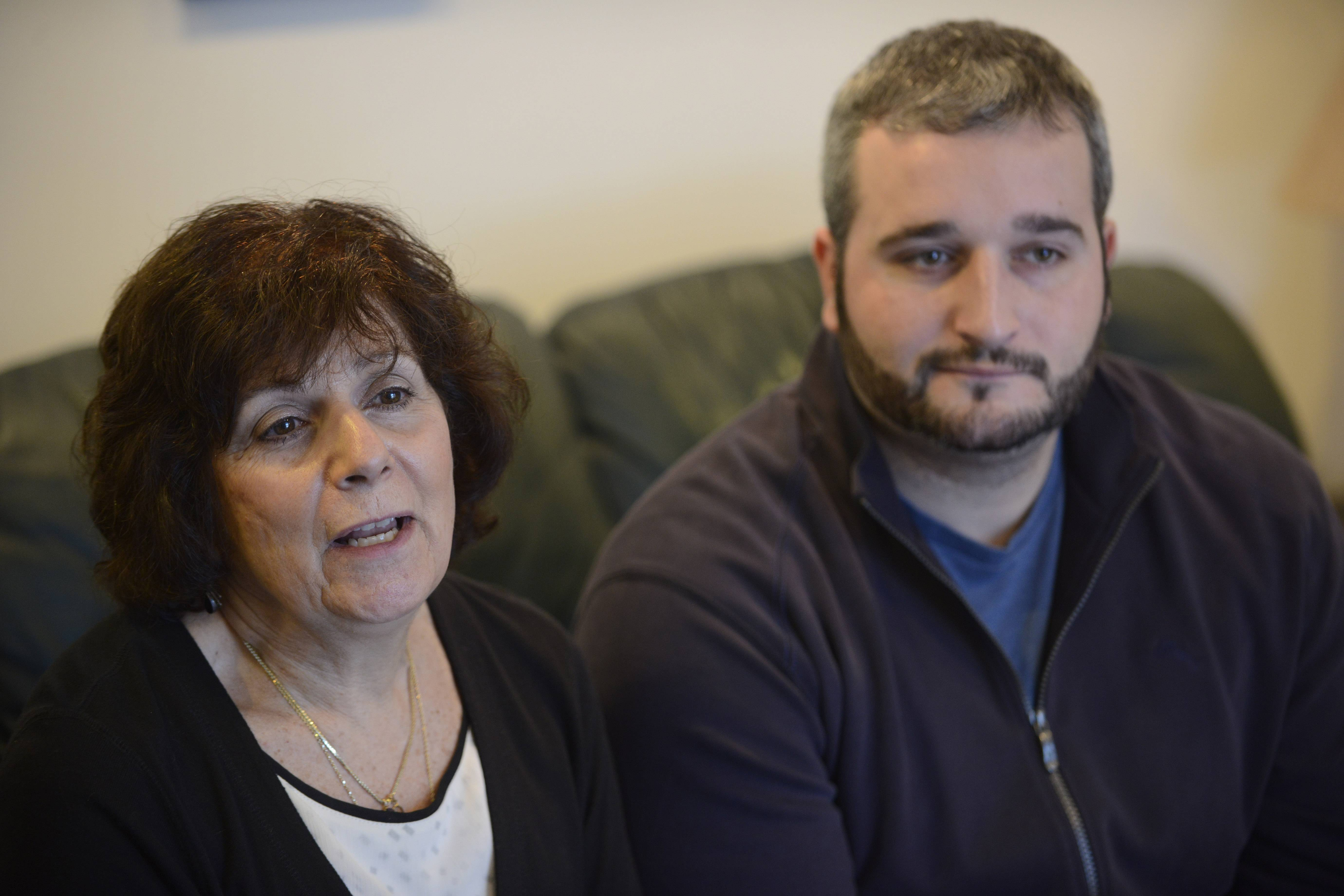 JOE LEWNARD/jlewnard@dailyherald.comPatty Bruce talks about her late husband, John, as her son, JP, listens. The family of the late John Bruce of Arlington Heights won a $6.65 million judgment in its wrongful death suit against CAV International.