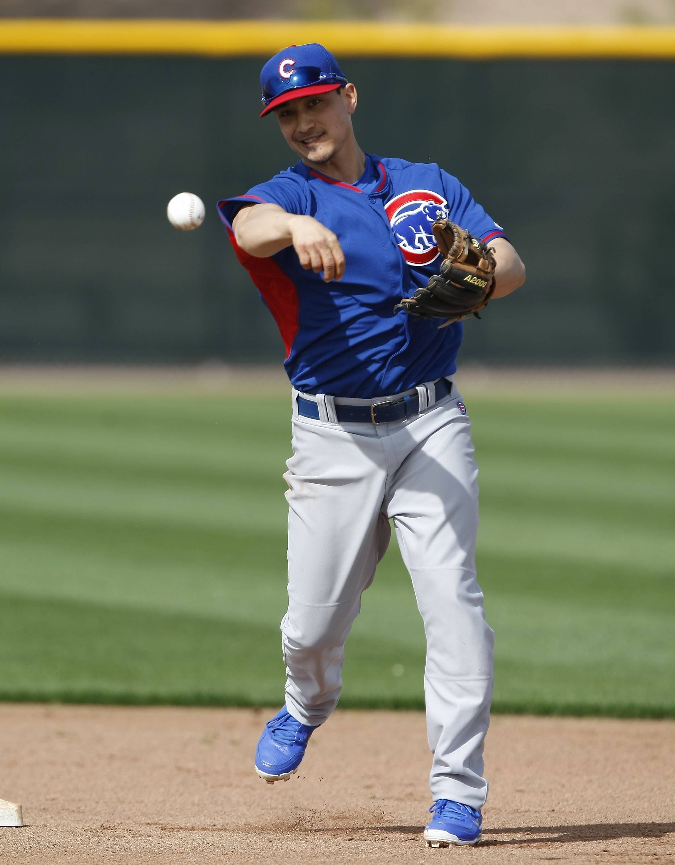 Cubs second baseman Darwin Barney fields grounders during spring-training baseball practice, Wednesday, Feb. 19, 2014, in Mesa, Ariz.