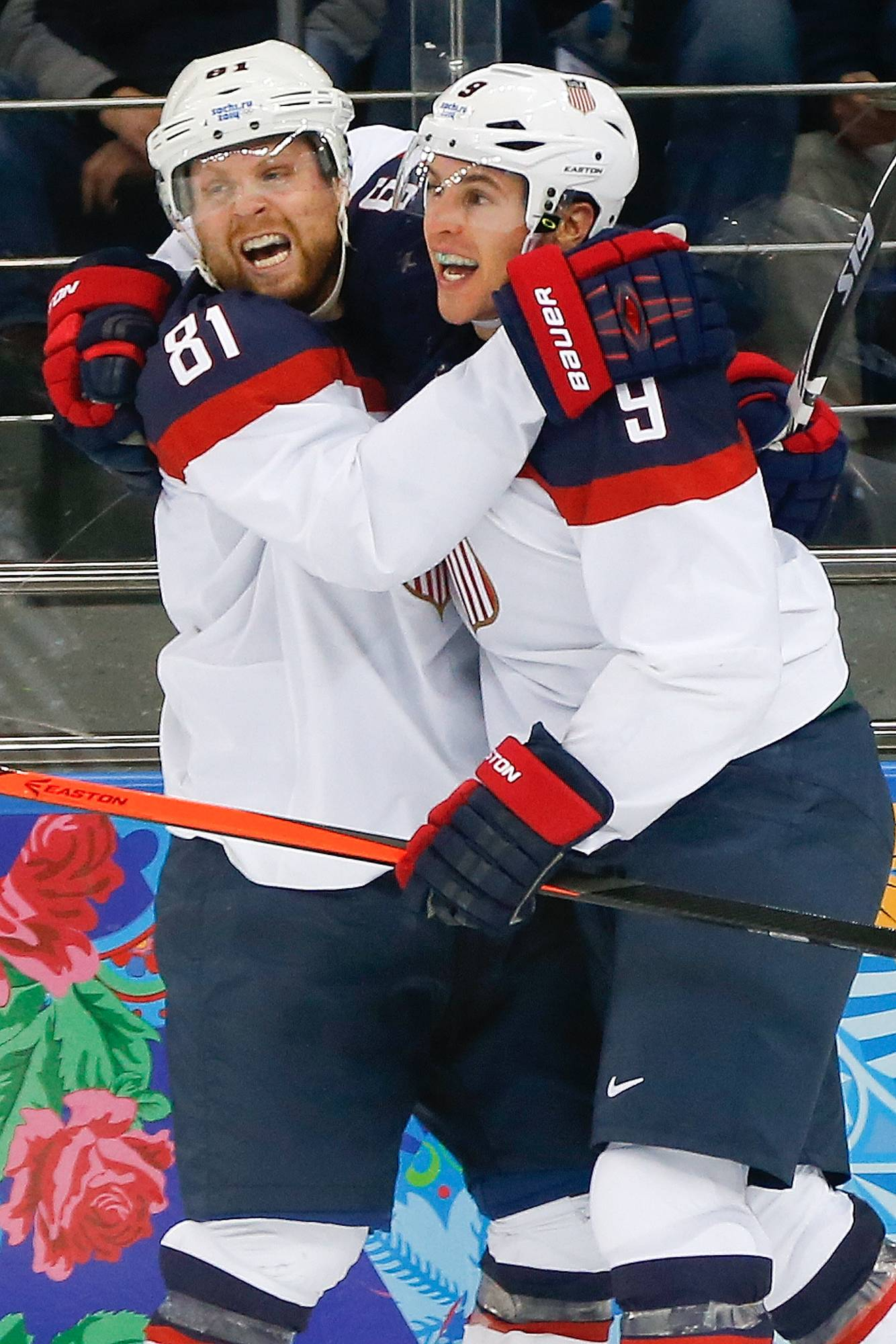 USA forward Zach Parise (9) celebrates his goal with teammate Phil Kessel (81) during the second period of men's quarterfinal hockey game against the Czech Republic.